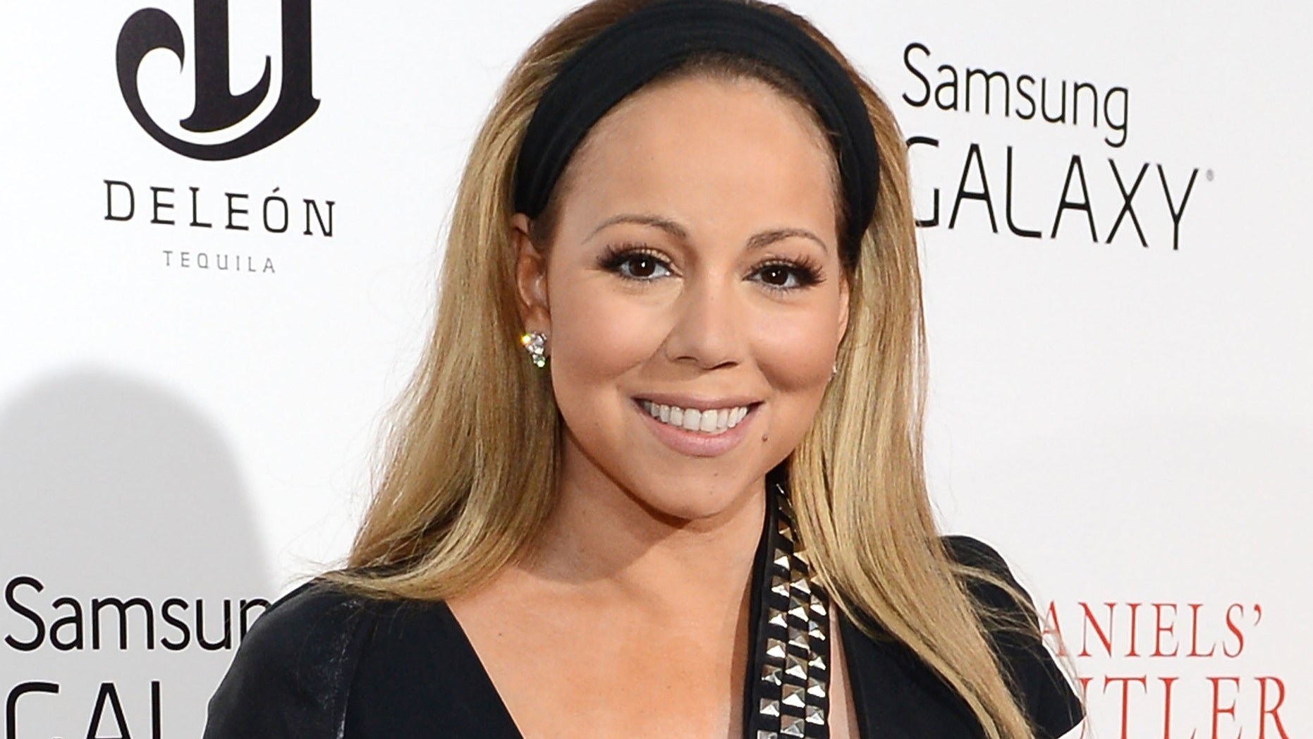 """NEW YORK, NY - AUGUST 05:  Mariah Carey attends Lee Daniels' """"The Butler"""" New York premiere, hosted by TWC, DeLeon Tequila and Samsung Galaxy on August 5, 2013 in New York City.  (Photo by Larry Busacca/Getty Images for The Weinstein Company)"""
