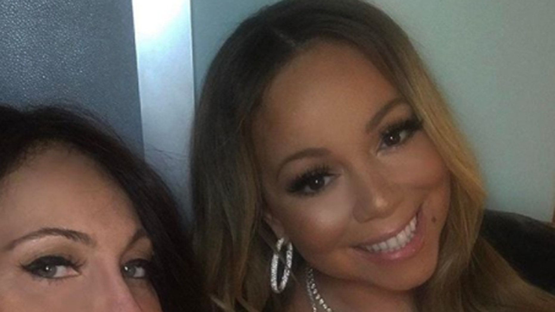 Stella Bulochnikov and Mariah Carey pose for a selfie prior to Bulochnikov's firing.
