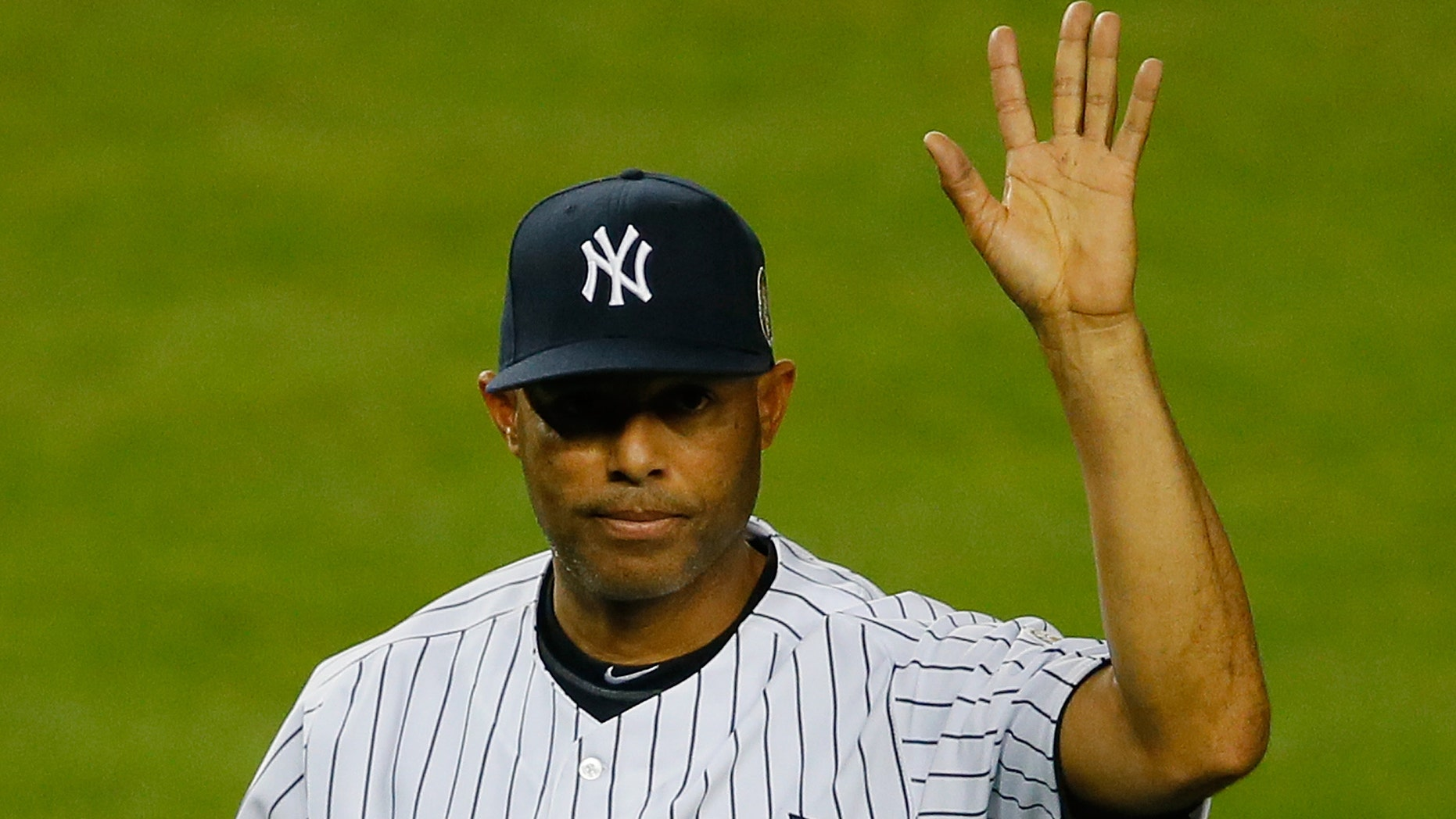 NEW YORK, NY - SEPTEMBER 26:  Mariano Rivera #42 of the New York Yankees walks back to the dugout after collecting some dirt from the pitcher's mound after the game against the Tampa Bay Rays at Yankee Stadium on September 26, 2013 in the Bronx borough of New York City.  (Photo by Mike Stobe/Getty Images)