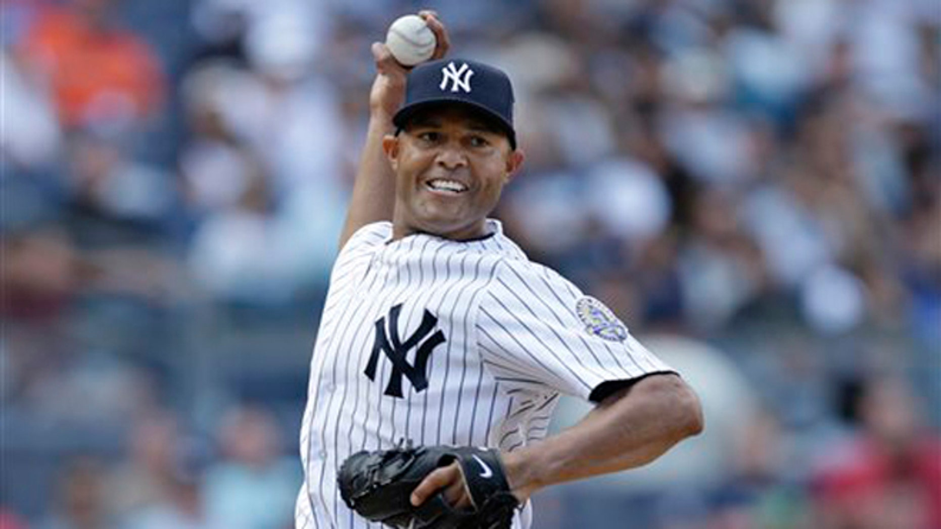 New York Yankees relief pitcher Mariano Rivera (42) throws to first on a pickoff  move in the eighth inning of a baseball game against the San Francisco Giants in New York.