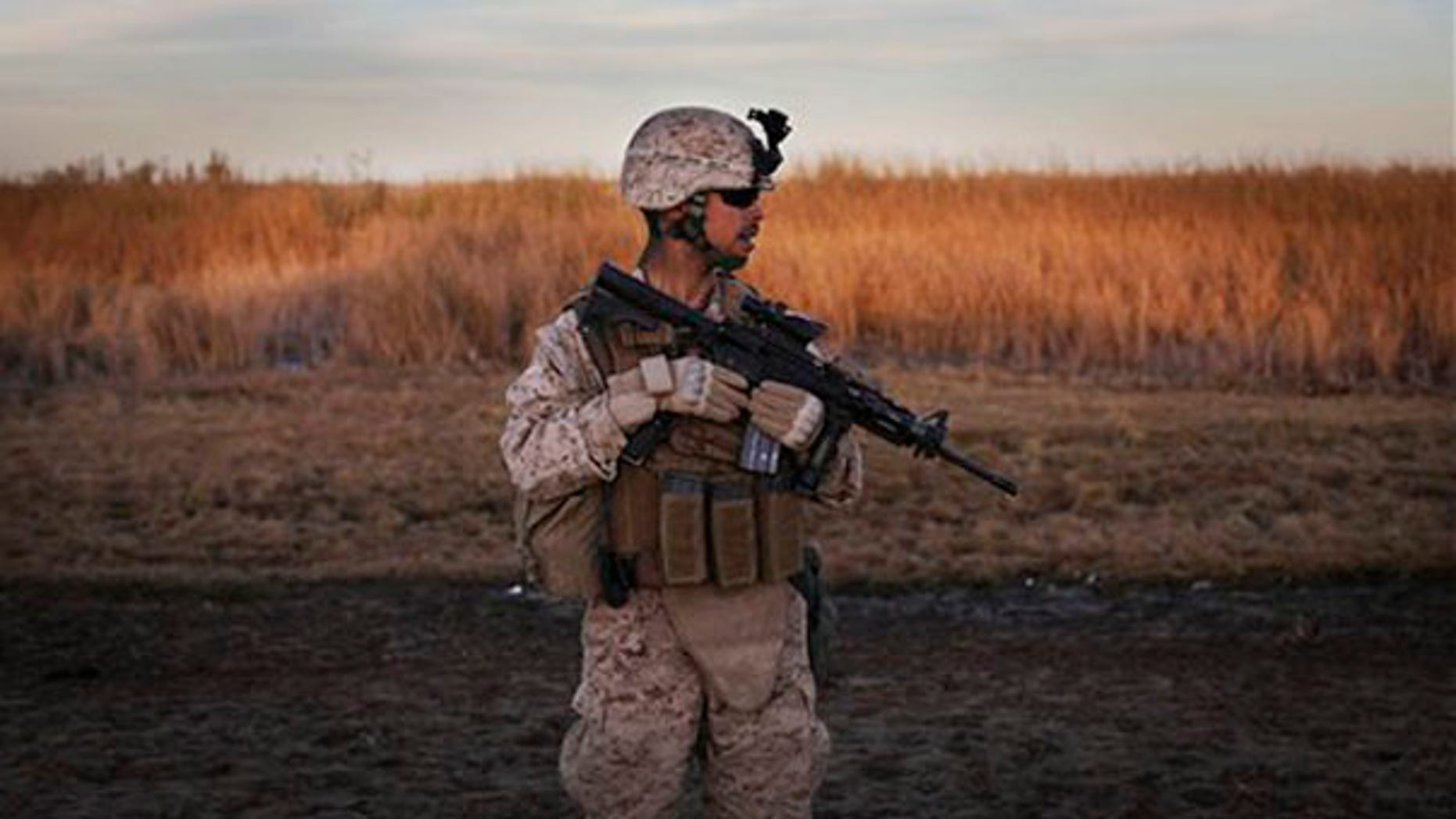 "A U.S. Marine from the 2nd Battalion 2nd Marines ""Warlords"" patrols during an operation in the Helmand province of Afghanistan Dec. 18. (AP Photo)"