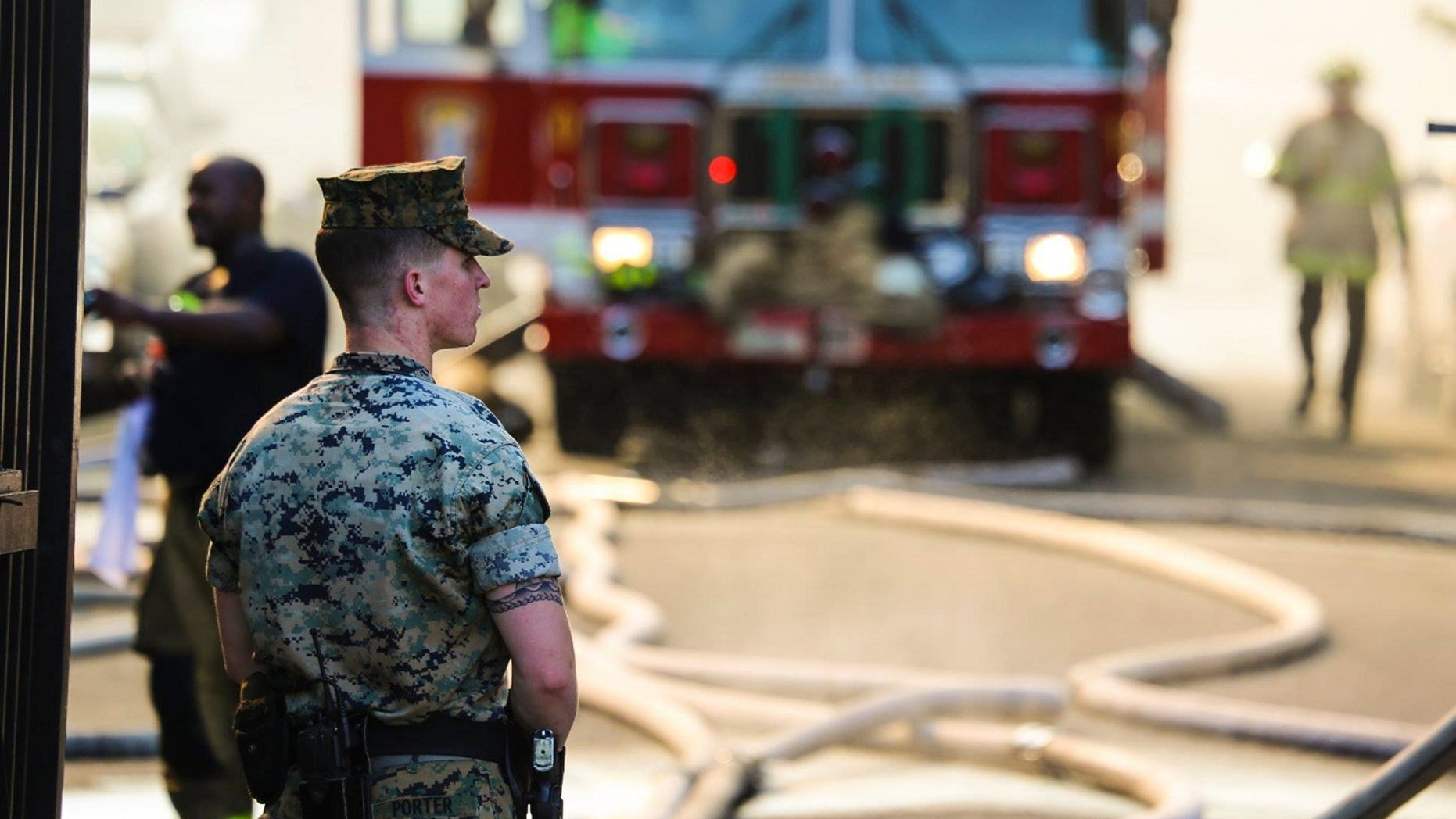 A group of Marines ran toward an apartment fire housing senior citizens in Washington D.C. to help in the rescue efforts.
