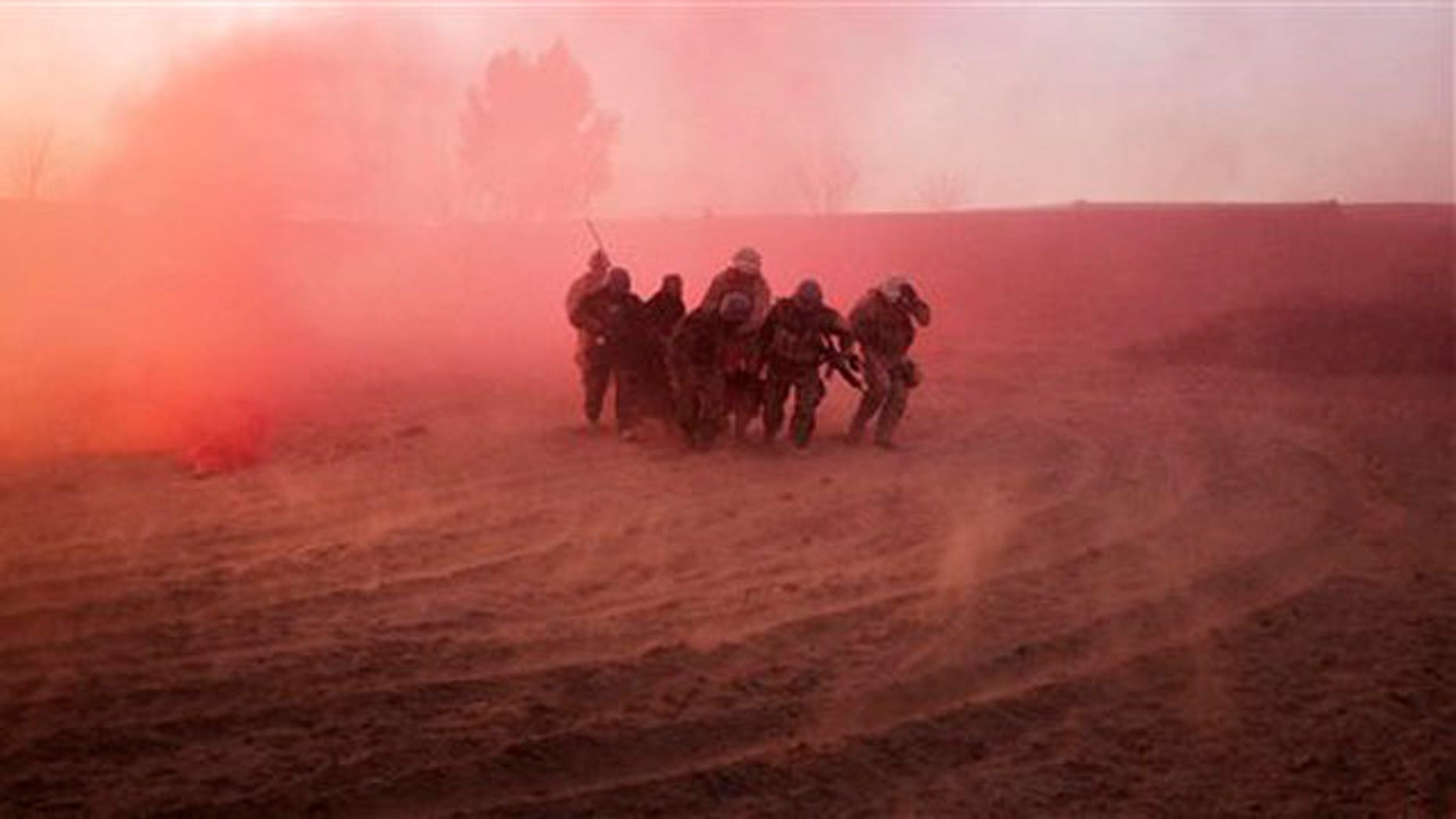 U.S. Marines and Afghan Army soldiers run with a wounded Afghan man to a waiting medevac helicopter near Marjah in southern Afghanistan Jan. 18.