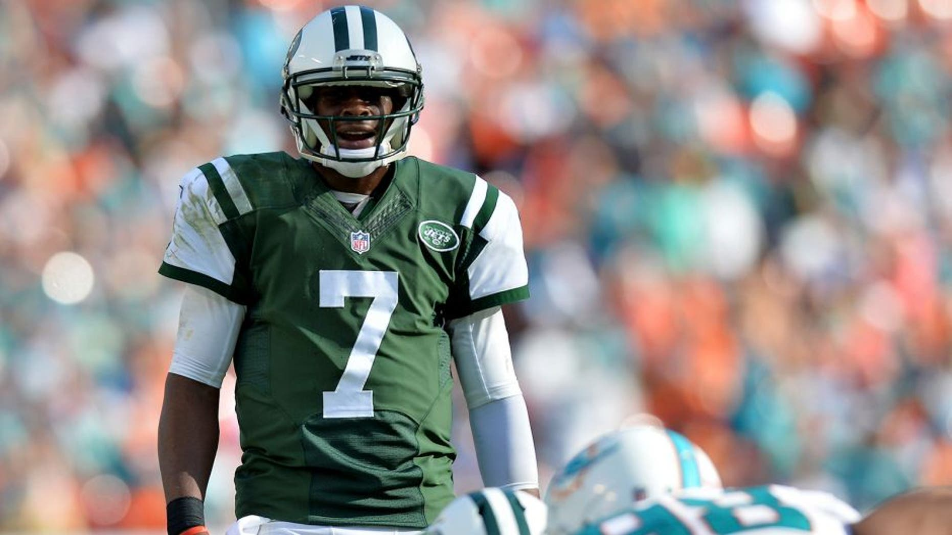 Dec 28, 2014; Miami Gardens, FL, USA; New York Jets quarterback Geno Smith (7) yells out from the line of scrimmage against the Miami Dolphins during the second half at Sun Life Stadium. Mandatory Credit: Steve Mitchell-USA TODAY Sports