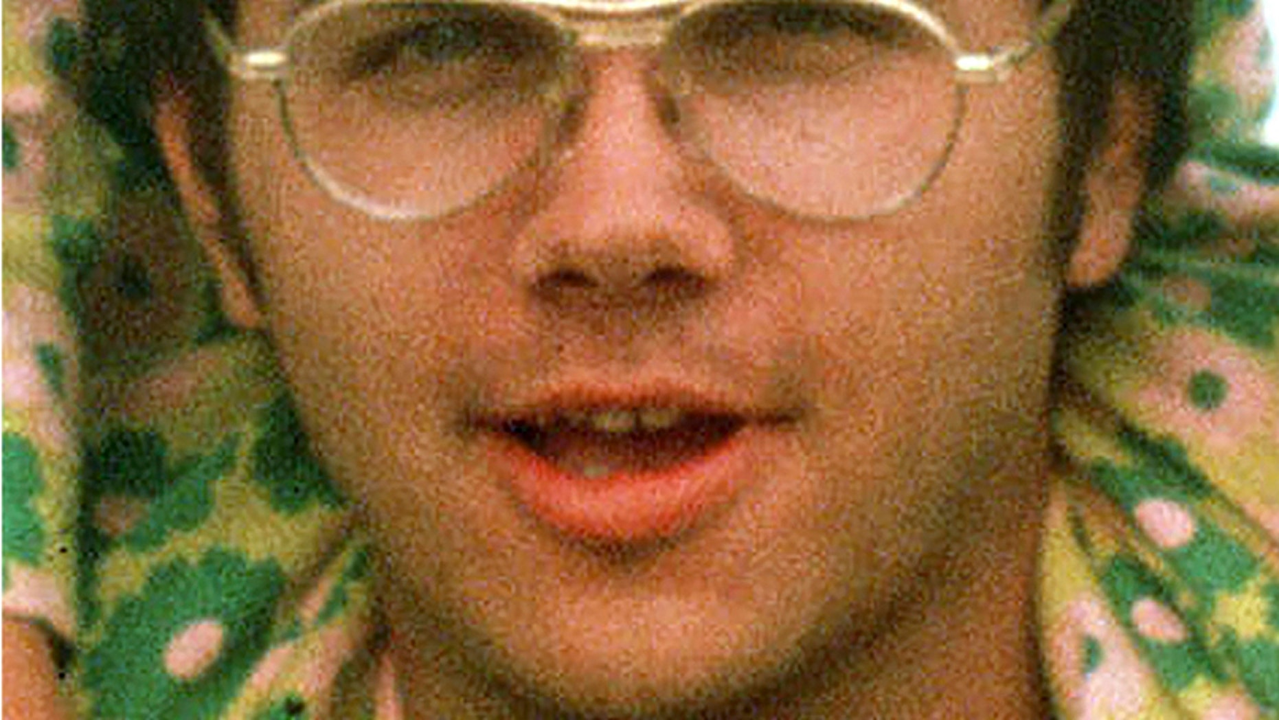 FILE - In this 1975 file photo, Mark David Chapman is seen at Fort Chaffee near Fort Smith, Ark.