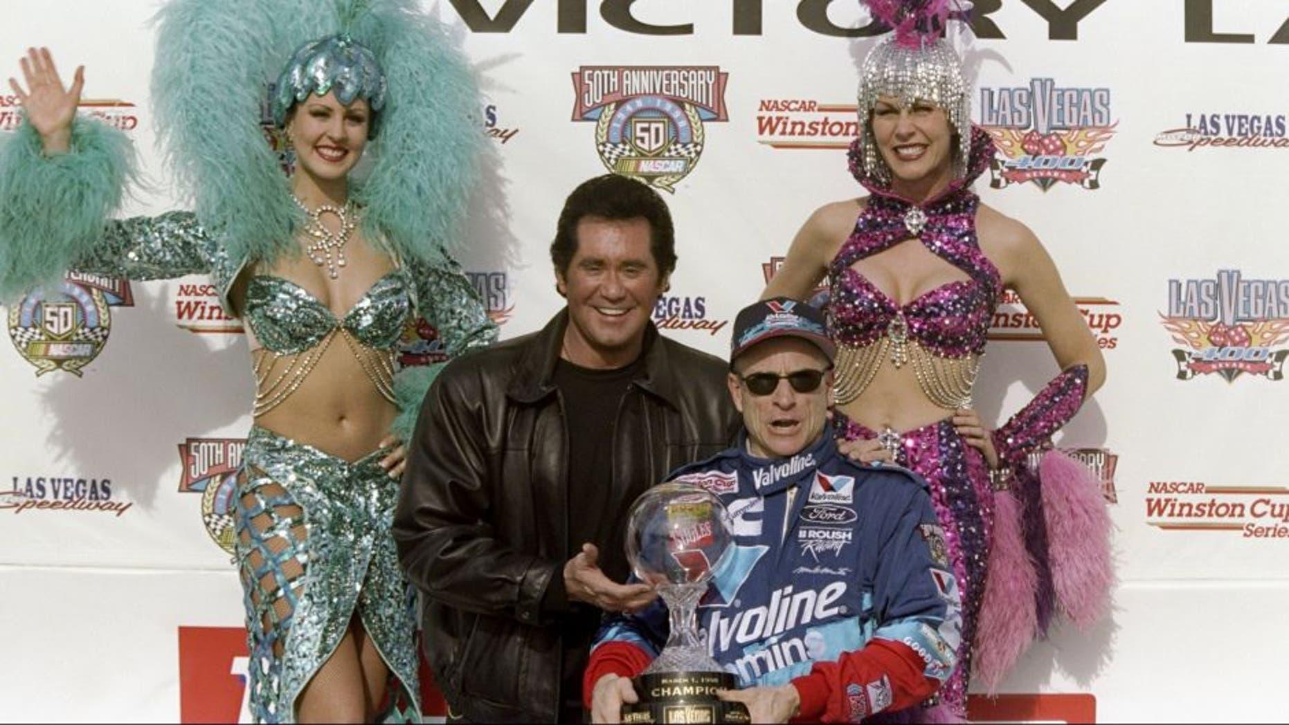 28 Feb 1998: Mark Martin celebrates after winning the Las Vegas 400 at the Las Vegas Motor Speedway in Las Vegas, Nevada. Mandatory Credit: David Taylor /Allsport