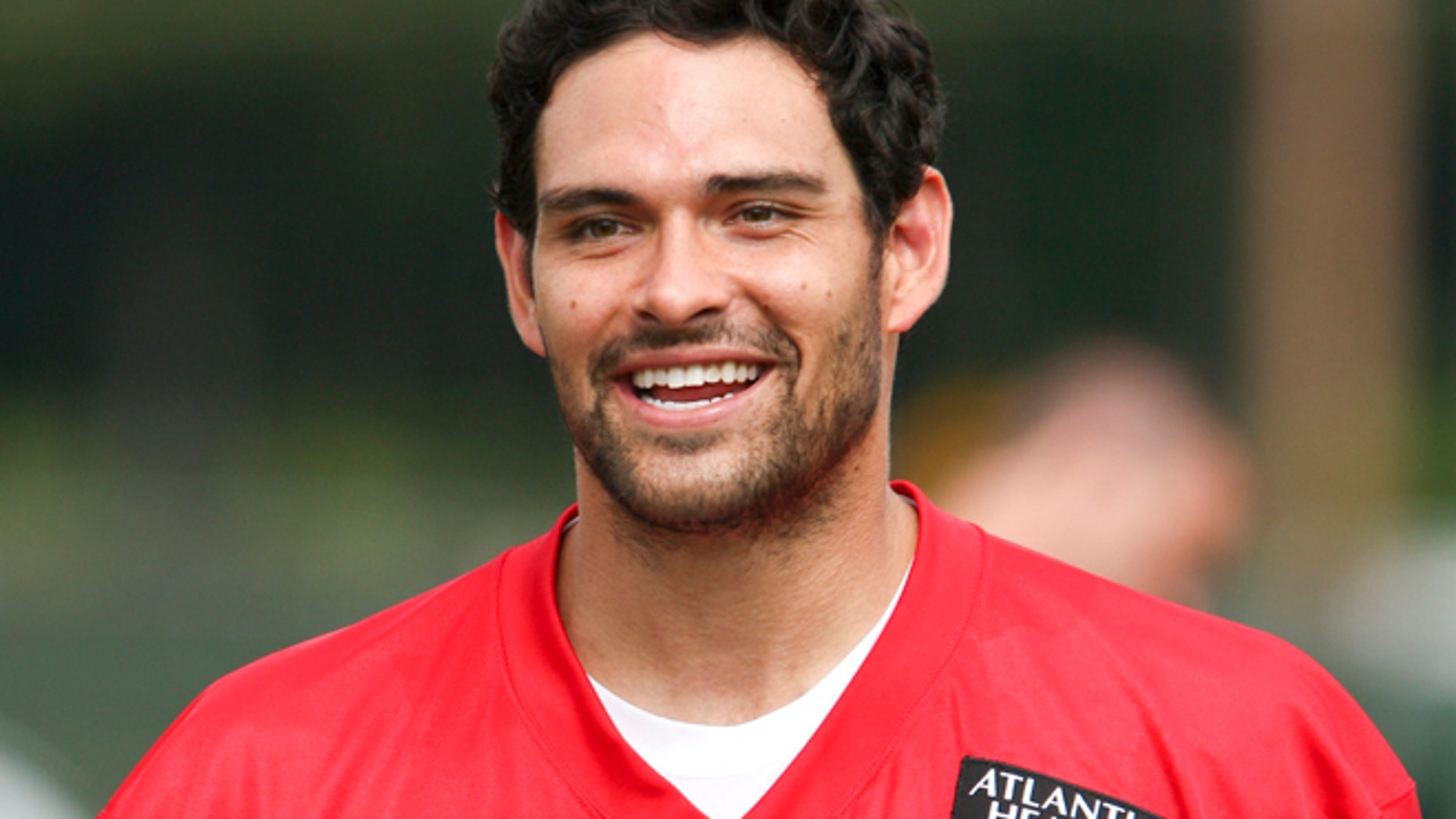 New York Jets quarterback Mark Sanchez smiles during Jets training camp practice in Cortland, New York, July 27, 2012.