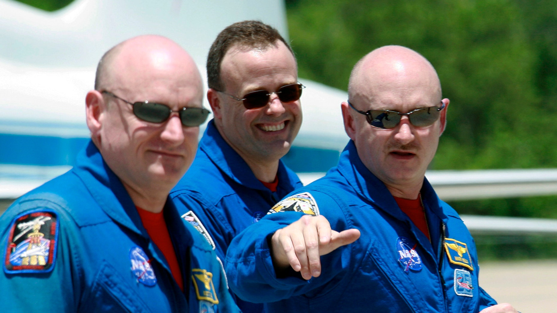 May 28, 2008: Space shuttle Discovery commander Mark Kelly, right, gestures as he walks with his twin brother, astronaut Scott Kelly, left, and mission specialist Ron Garan, after arrival at Kennedy Space Center in Cape Canaveral, Fla.
