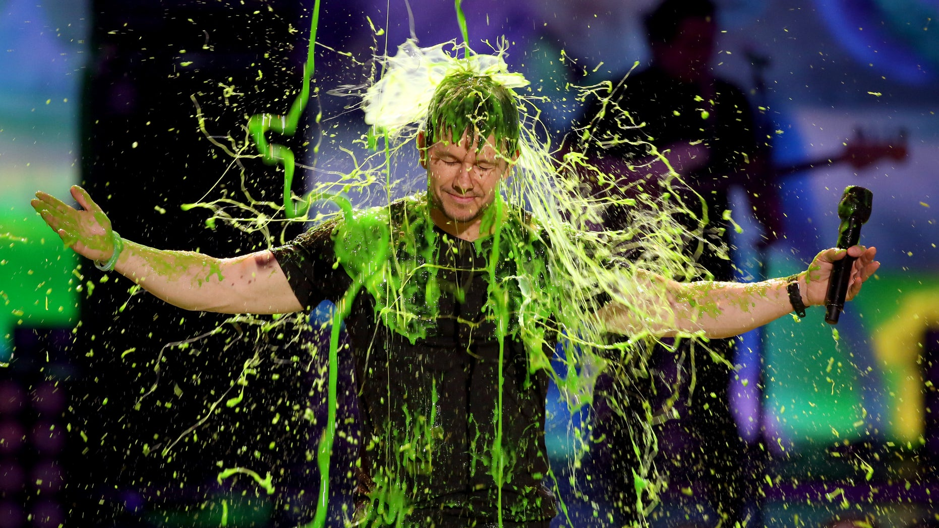 March 29, 2014. Mark Wahlberg gets slimed at the 27th annual Kids' Choice Awards at the Galen Center in Los Angeles.