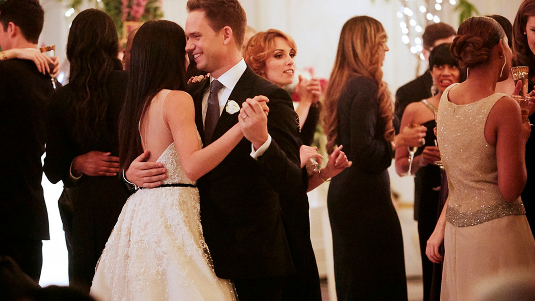 """Meghan Markle (left) as Rachel and Patrick J. Adams as Mike in the Season 7 finale of """"Suits."""""""