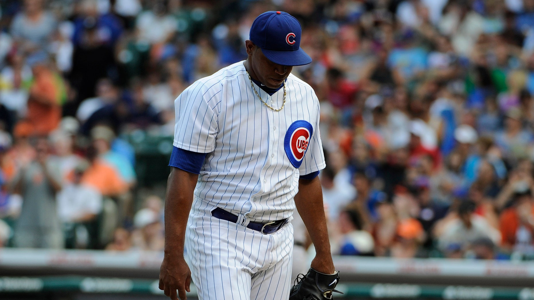 Carlos Marmol #49 of the Chicago Cubs walks of the mound. (Photo by David Banks/Getty Images)