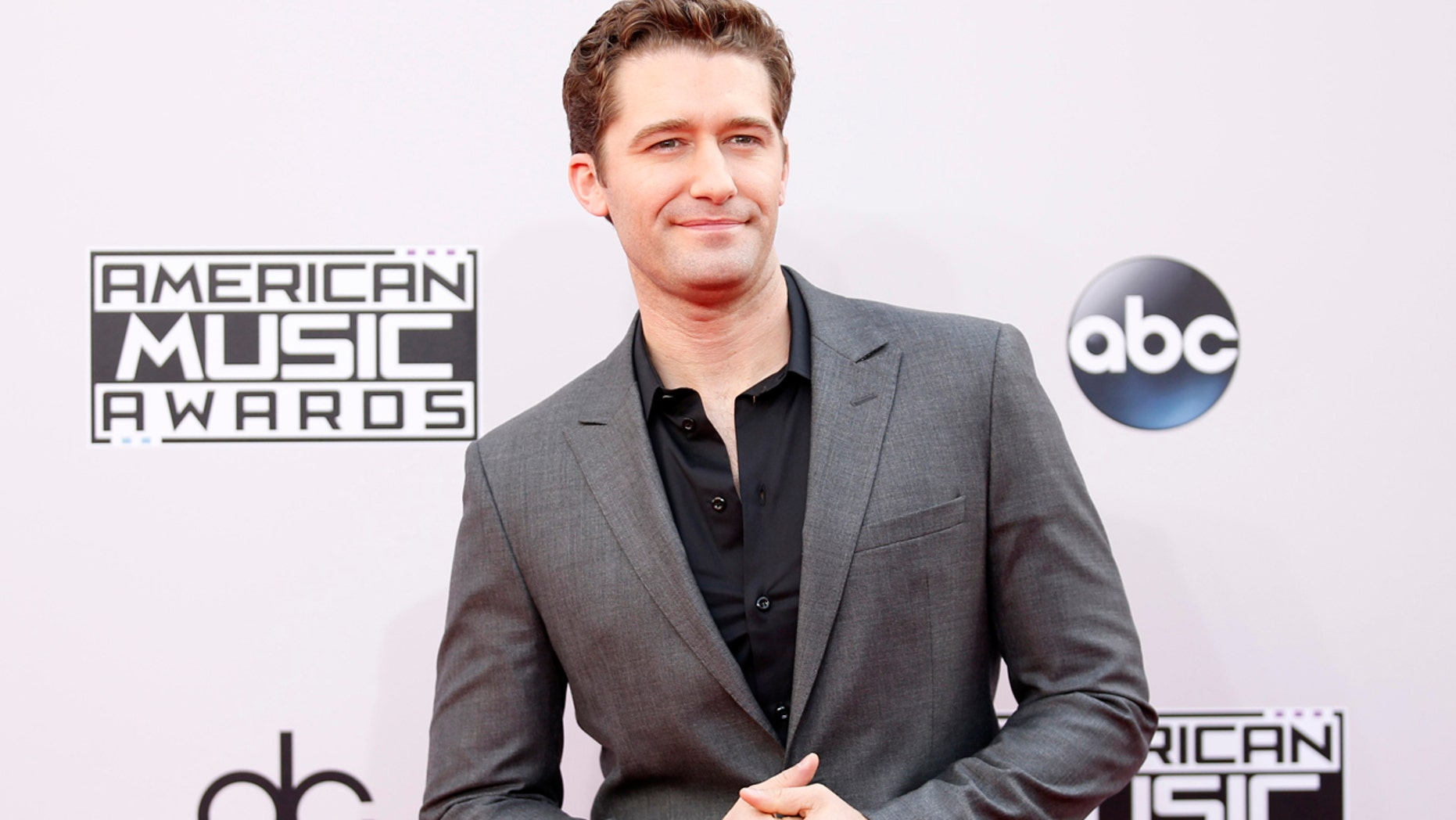 Actor Matthew Morrison arrives at the 42nd American Music Awards in Los Angeles, on Nov. 23, 2014.
