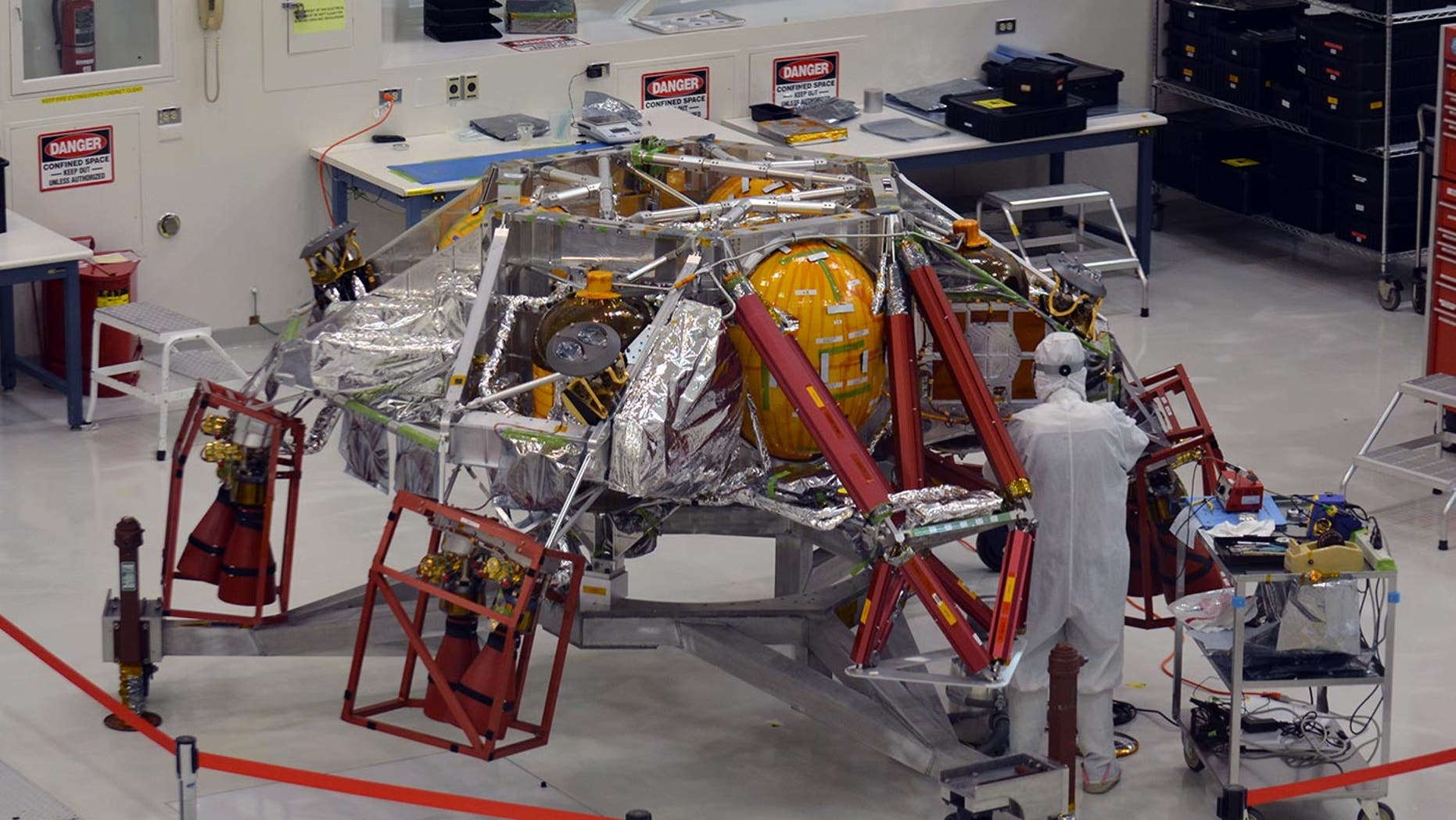 A technician works on the descent stage for NASA's Mars 2020 rover mission inside the Spacecraft Assembly Facility at the agency's Jet Propulsion Laboratory in Pasadena, California. The rover is scheduled to launch toward the Red Planet in July of 2020.