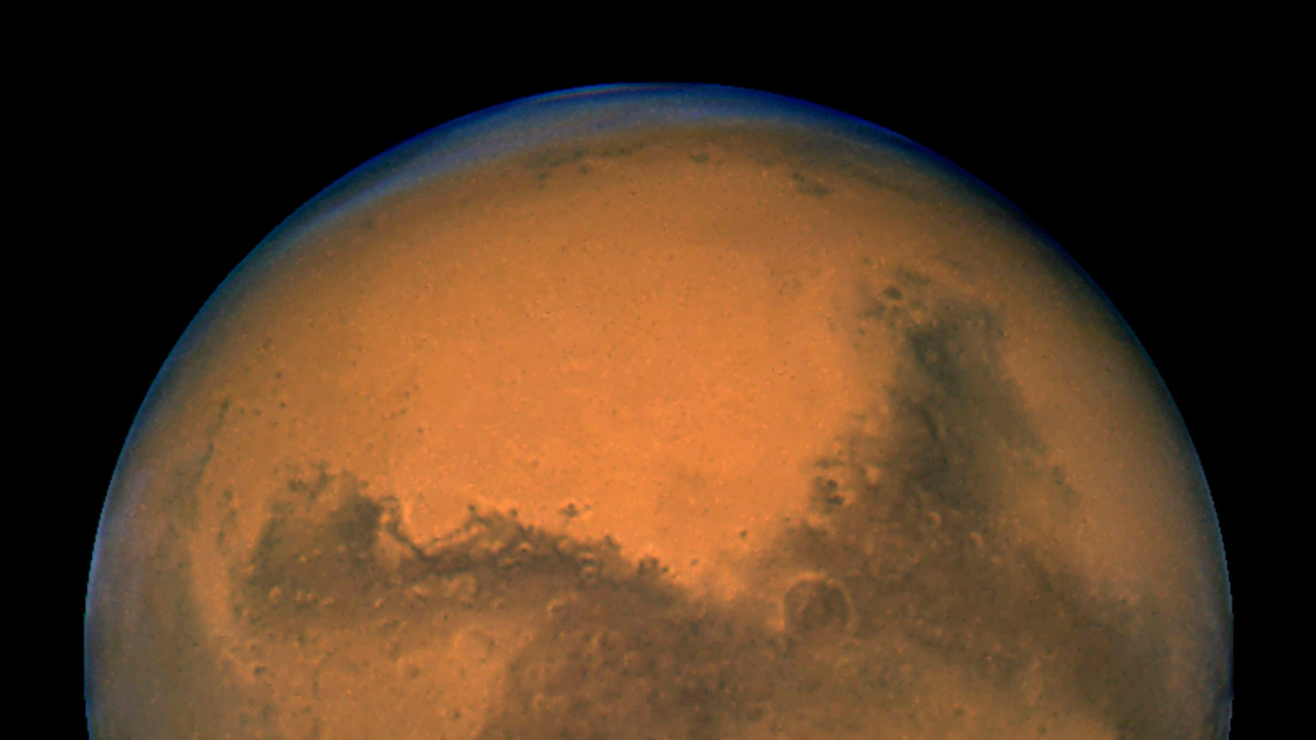 August 27, 2003: NASA's Hubble Space Telescope snapped this portrait of Mars within minutes of the planet's closest approach to Earth in nearly 60,000 years.