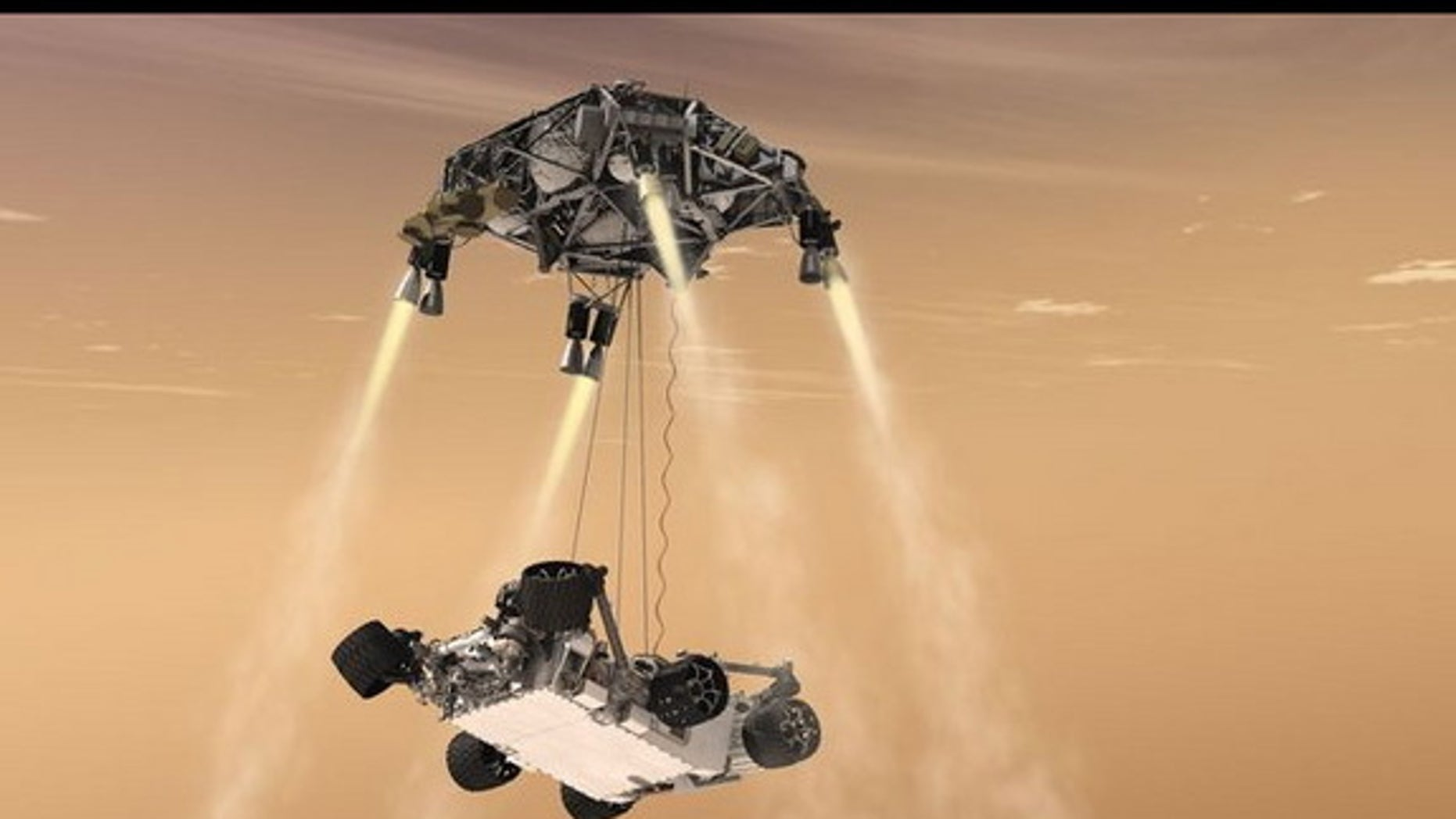 """This artist's concept shows the sky-crane maneuver during the descent of NASA's Curiosity rover to the Martian surface, which engineers dubbed """"seven minutes of terror."""" The Mars 2020 mission will leverage the design of this landing system and"""