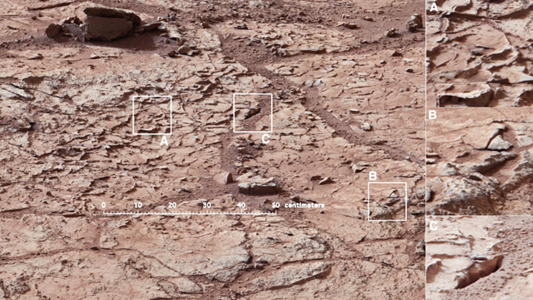 Jan. 10, 2013: The patch of veined, flat-lying rock selected as the first drilling site for NASA's Mars rover Curiosity. The area is shot full of fractures and veins, with the intervening rock also containing concretions, which are small spherical concentrations of minerals. At right, three boxes, each about 4 inches across, designate enlargements on the right that illustrate attributes of the area.