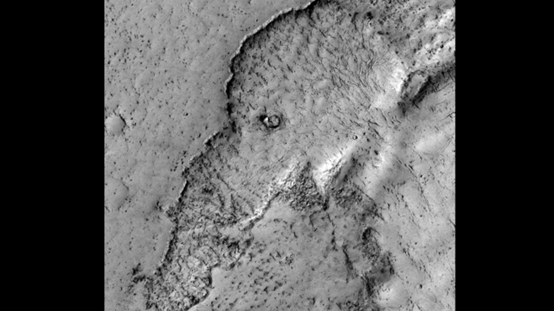 Apr. 4, 2012: This observation highlights Martian terrain that looks like an elephant. Actually, this image covers the margin of a lava flow in Elysium Planitia, the youngest flood-lava province on Mars. Flood lavas cover extensive areas, and were once thought to be emplaced extremely rapidly, like a flood of water.