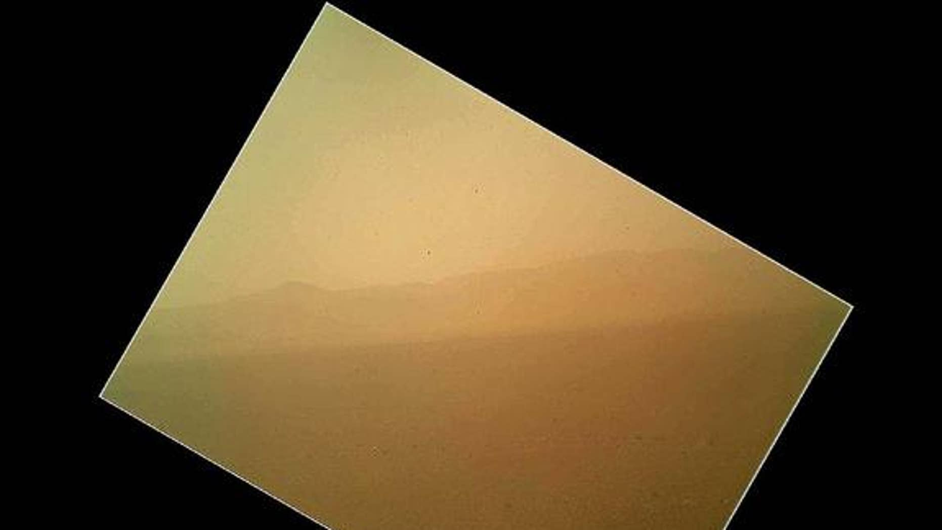 This photo taken by NASA's Mars rover Curiosity shows the north wall and rim of Gale Crater. The image is the first color photo snapped by Curiosity's Mars Hand Lens Imager (MAHLI) on the afternoon of the first day after landing. NASA released