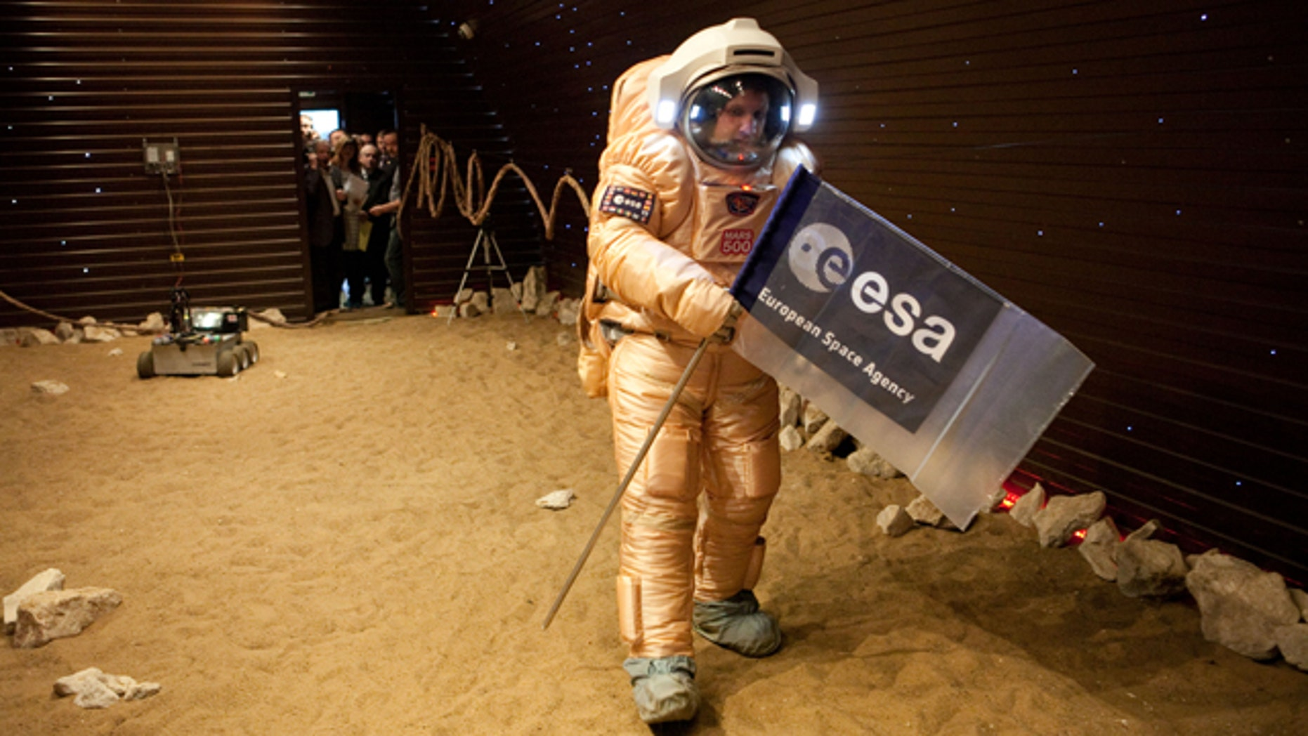 Crew training for 'Marswalk' at the simulated martian terrain of the Mars500 experiment. The terrain, about 10 m long and 6 m wide, is covered with reddish sand and is built to resemble the surface at Gusev crater.