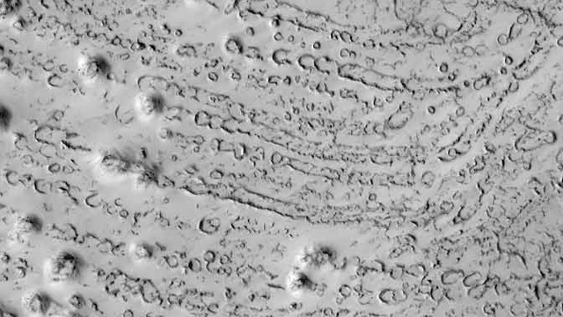 Chains of crater marks on Mars such as these could have been made by icebergs rolling across ancient Martian ocean floors, researchers suggest.