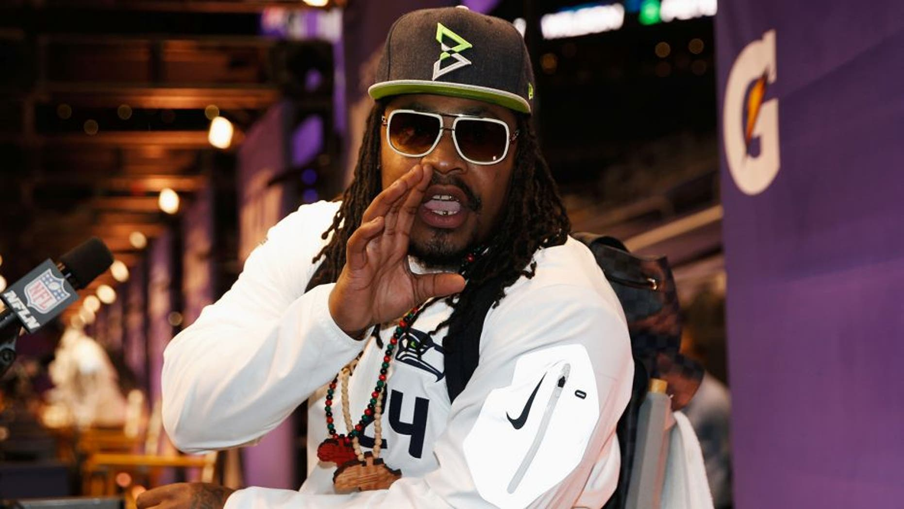 PHOENIX, AZ - JANUARY 27: Marshawn Lynch #24 of the Seattle Seahawks addresses the media at Super Bowl XLIX Media Day Fueled by Gatorade inside U.S. Airways Center on January 27, 2015 in Phoenix, Arizona. (Photo by Christian Petersen/Getty Images)