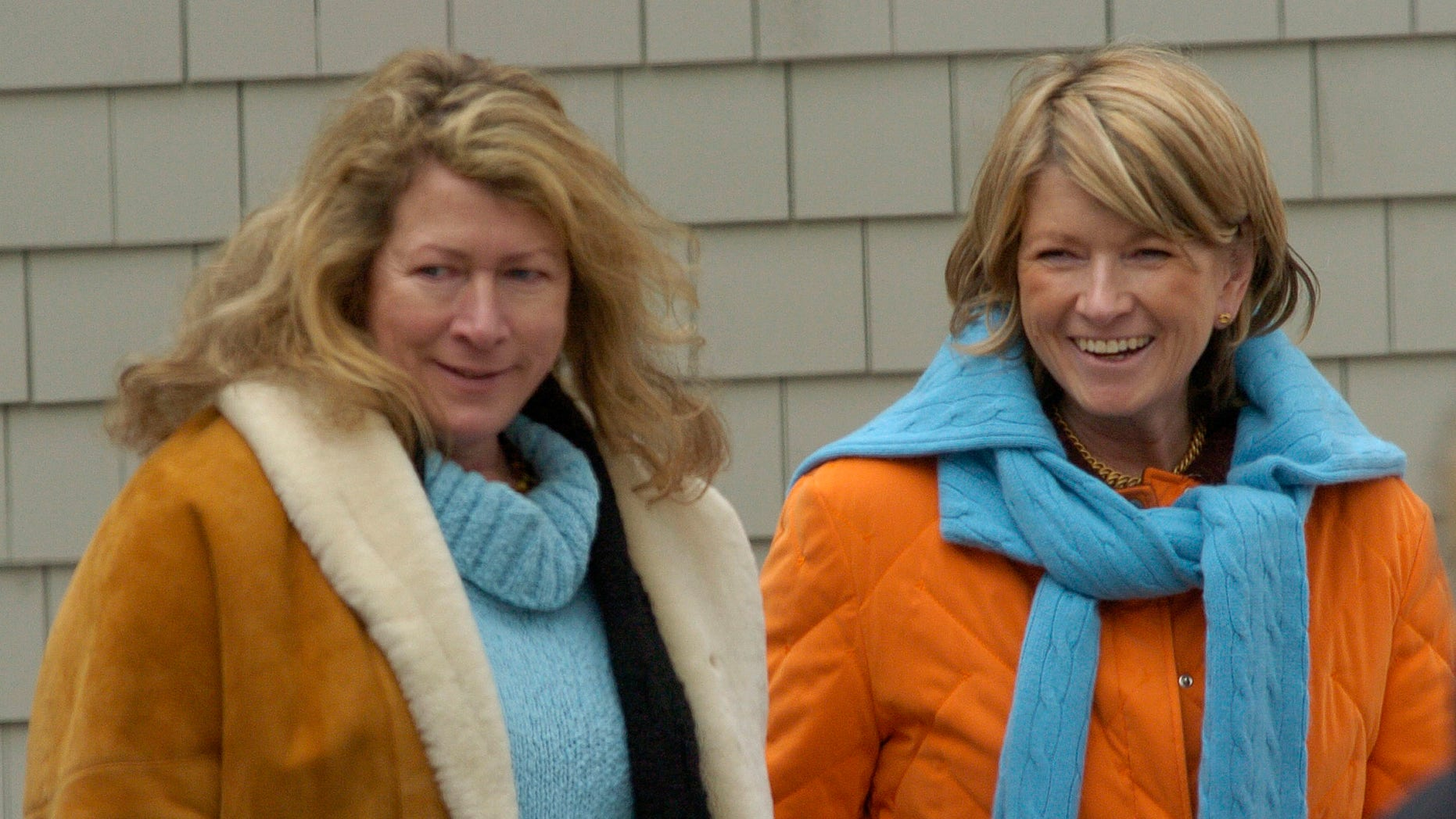 Martha Stewart (R) walks on the grounds of her estate with her sister Laura Plimpton (L) in Bedford, New York, March 6, 2005. Stewart, the lifestyle trendsetter who built a media empire, was released from prison and began five months of house arrest as she works to rehabilitate her image. REUTERS/Chip East  CME - RTR44GE