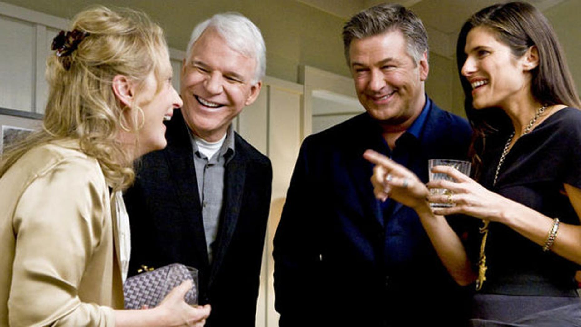 Steve Martin and Alec Baldwin are all smiles in this scene from 'It's Complicated,' but will the pairing work on March 7? (AP)
