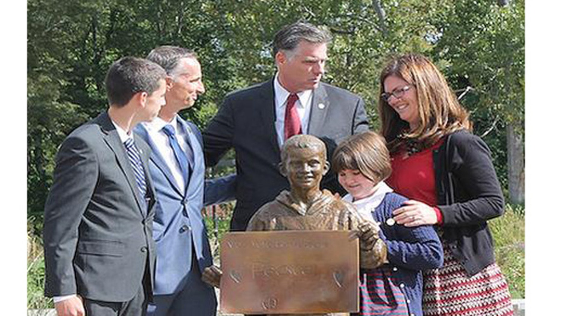 A life-size sculpture of Boston Marathon bombing victim Martin Richard unveiled Saturday Sept. 26, 2015, at Bridgewater State University.(John Waters/BSU)
