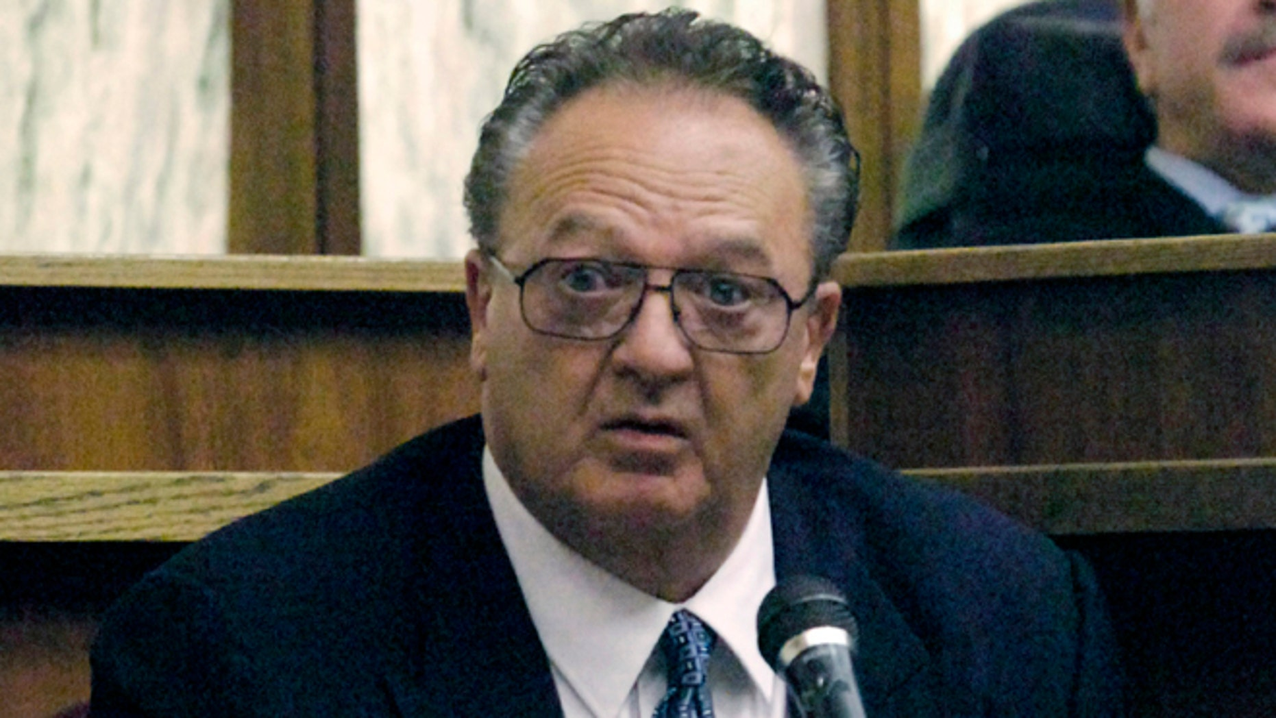 Sept. 17, 2008: John Martorano is questioned about his plea agreement in exchange for testifying against former FBI agent John Connolly, in the Miami Courthouse. Connolly is accused of helping the Boston mob murder Miami gambling executive John Callahan in 1982, at Miami International Airport.  Martorano, who served 12 years in prison after a plea deal, and who has admitted killing 20 people, is expected to testify at the trial of James 'Whitey' Bulger in federal court in Boston. (AP/Marice Cohn Band, Pool, File)