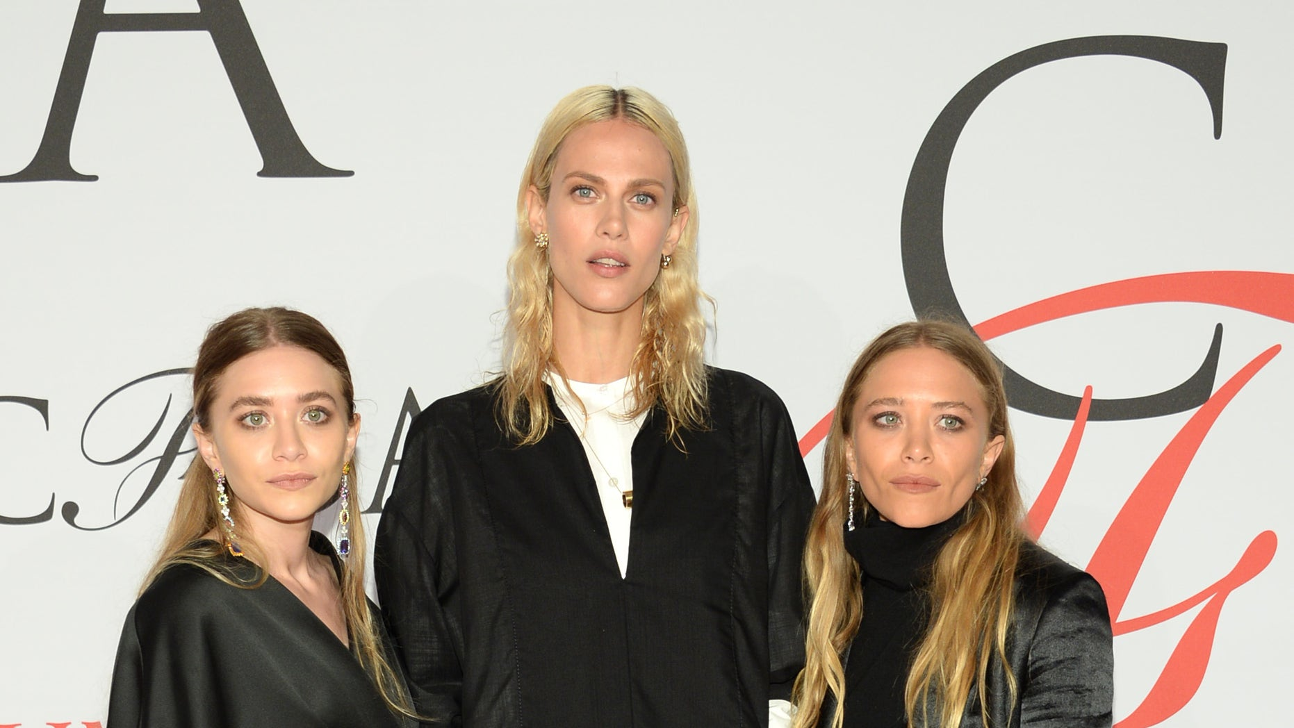 Ashley Olsen, from left, Aymeline Valade and Mary-Kate Olsen arrive at the 2015 CFDA Fashion Awards at Alice Tully Hall, Lincoln Center, on Monday, June 1, 2015, in New York. (Photo by Evan Agostini/Invision/AP)