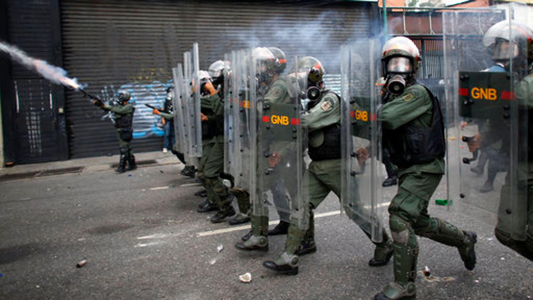Bolivarian National Guards block protesters from reaching the national ombudsman office in Caracas, Venezuela, April 26, 2017.