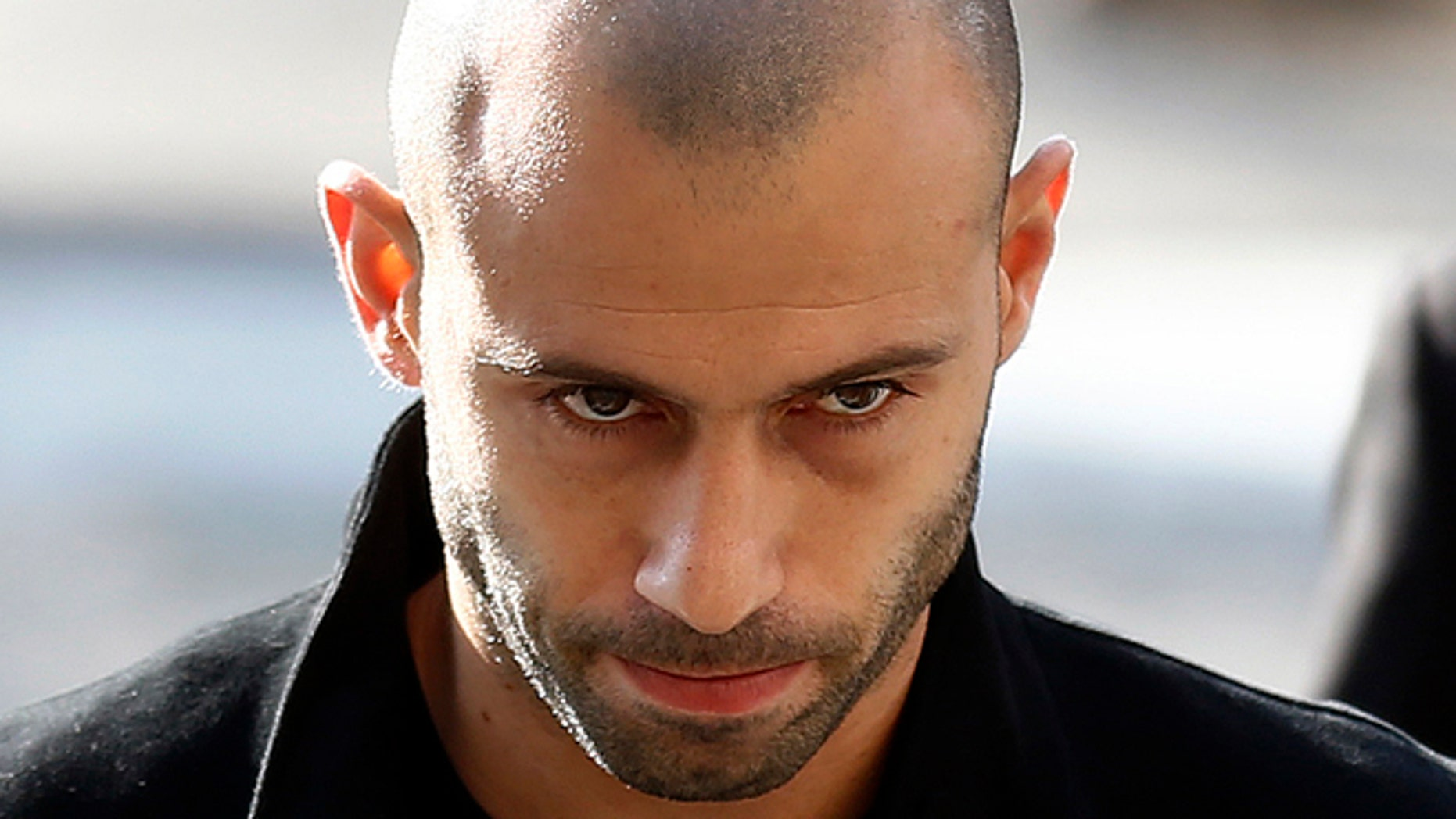 FC Barcelona defender Javier Mascherano, from Argentina, leaves the court after answering questions in a tax fraud case in Barcelona, Spain, Thursday, Jan. 21, 2016. Mascherano has accepted a one-year prison sentence for not properly paying taxes in Spain but is not expected to face any jail time. The sentencing on Thursday came nearly three months after the Barcelona defender had reached a deal with prosecutors and the attorneyís office for failing to pay nearly 1.5 million euros ($1.6 million) in taxes for 2011 and 2012.  (AP Photo/Manu Fernandez)