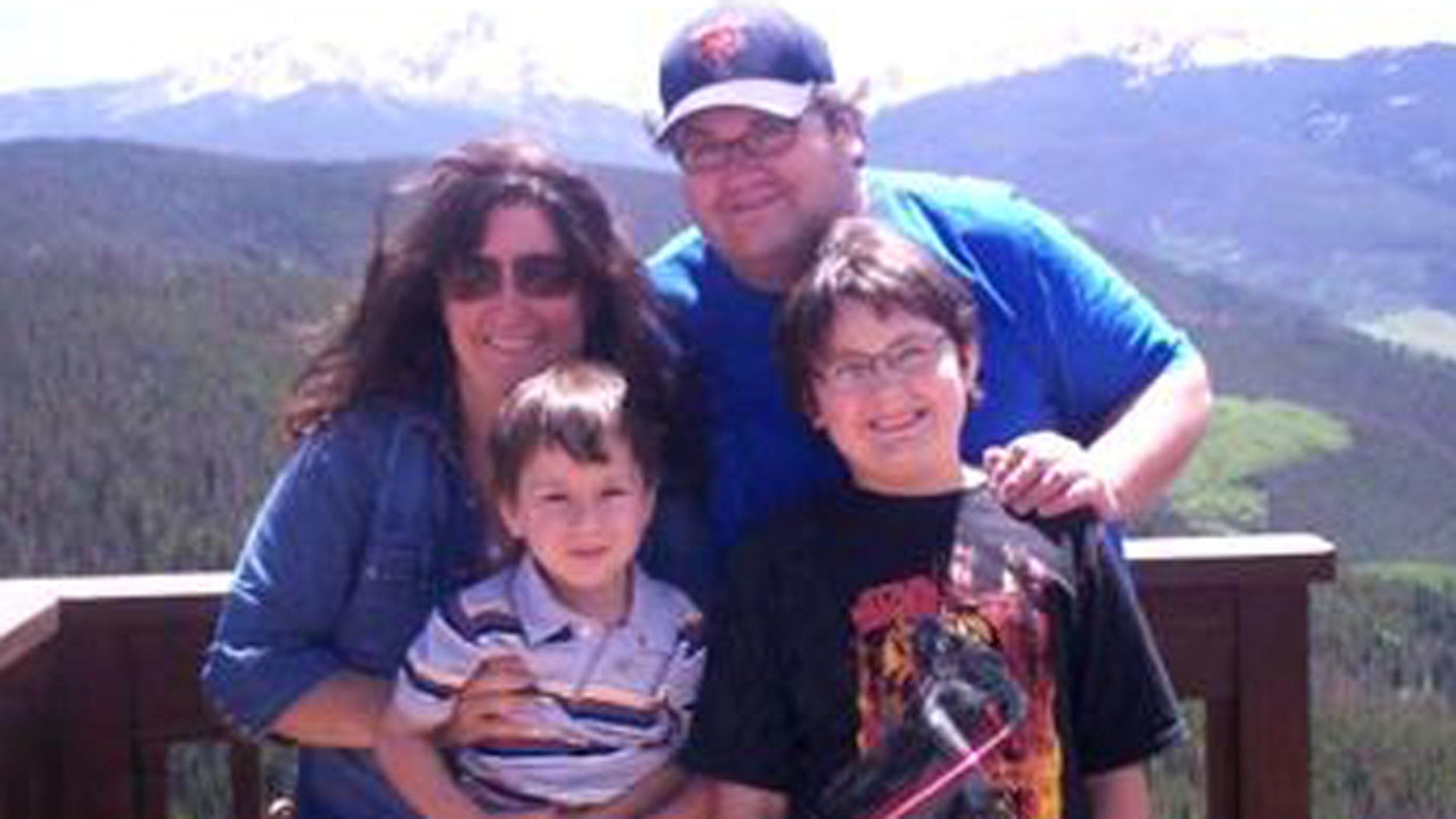 Mason Parrish, front right, with his father, mother and brother.