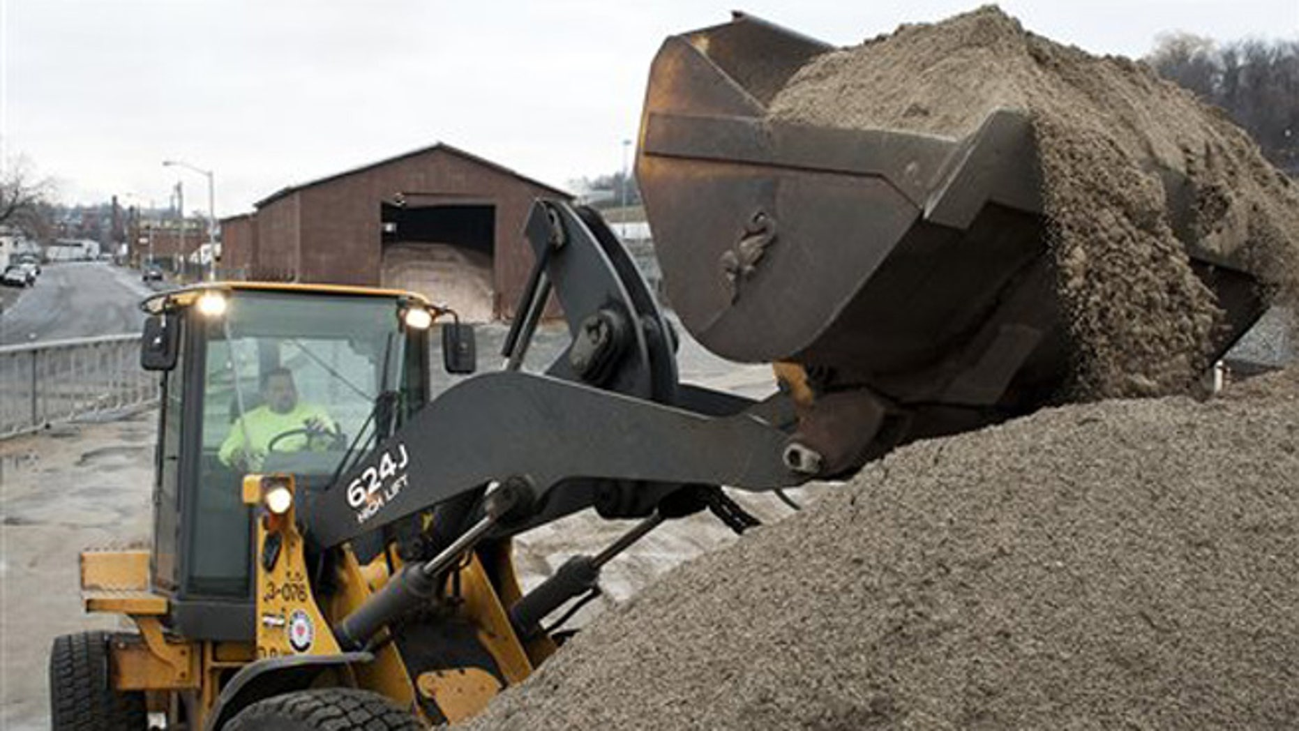 Joseph Lebeau mixes road sand and salt at the Department of Public Works facility in Worcester, Mass., as the Worcester DPW prepares for winter weather.