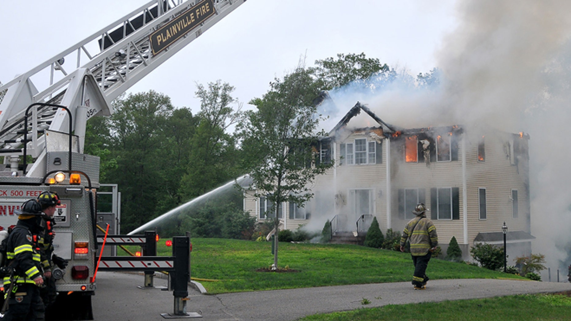 June 28, 2015: Firefighters work to extinguish flames after a small plane crashed into a house in Plainville, Mass. Jim Peters of the Federal Aviation Administration says the Beechcraft plane crashed into the house at about 5:45 p.m. Sunday. It had taken off from Lancaster Airport in Pennsylvania and was en route to an airport in Norwood, Mass.