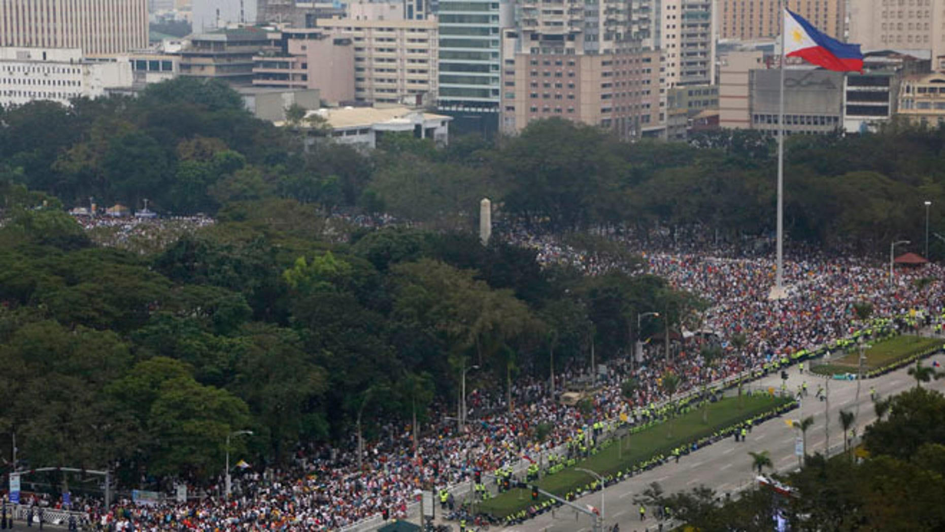 Jan. 18, 2015: Tens of thousands of the faithful fill the Rizal Park area where Pope Francis is to celebrate Mass to an estimated six million in Manila, Philippines. (AP)