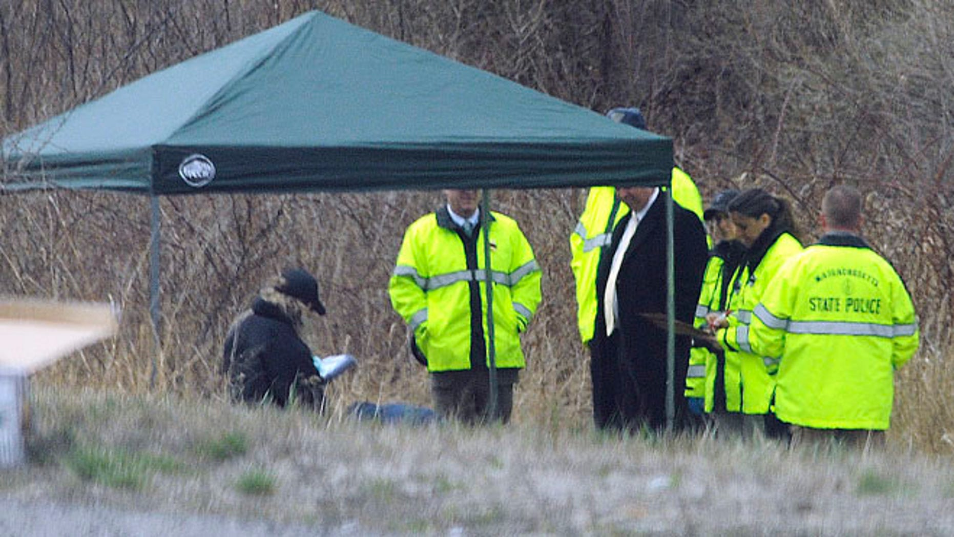 Apr. 18, 2014: Massachusetts State Police stand along Interstate 190 where police said a child's body was found near Sterling, Mass.