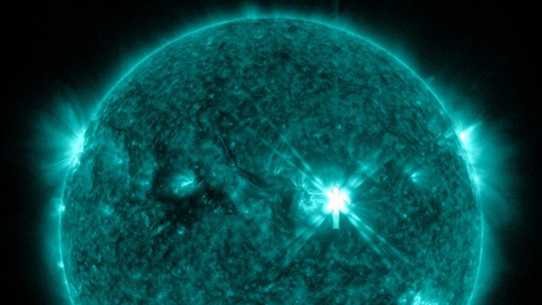 Sept. 6, 2011: This image taken by NASA's Solar Dynamics Observatory watching the sun shows a powerful solar flare (center right) just minutes after it erupted on 6:20 p.m. EDT (2220 GMT).