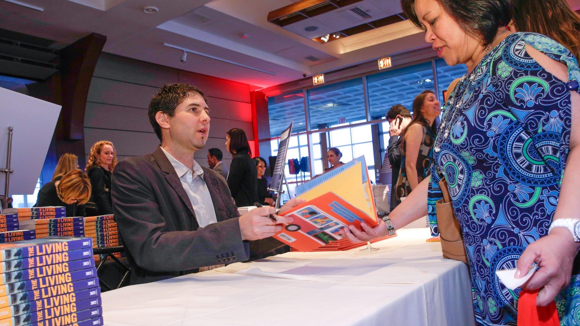 Author Matt De La Pena in a book signing on April 16, 2015 in New York City.