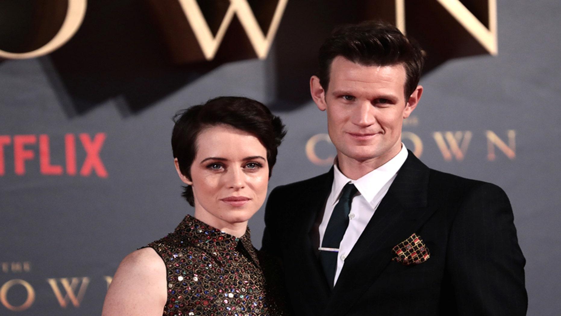 "Actors Claire Foy, who plays Queen Elizabeth II, and Matt Smith who plays Philip Duke of Edinburgh, attend the premiere of ""The Crown"" Season 2 in London, Britain, November 21, 2017. REUTERS/Simon Dawson - RC111B38EA60"