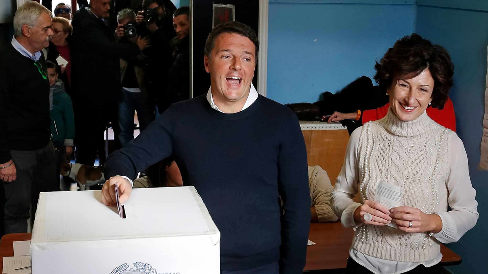 Dec. 4, 2016: Italian Premier Matteo Renzi is flanked by his wife Agnese as he casts his ballot at a polling station in Pontassieve, Italy.