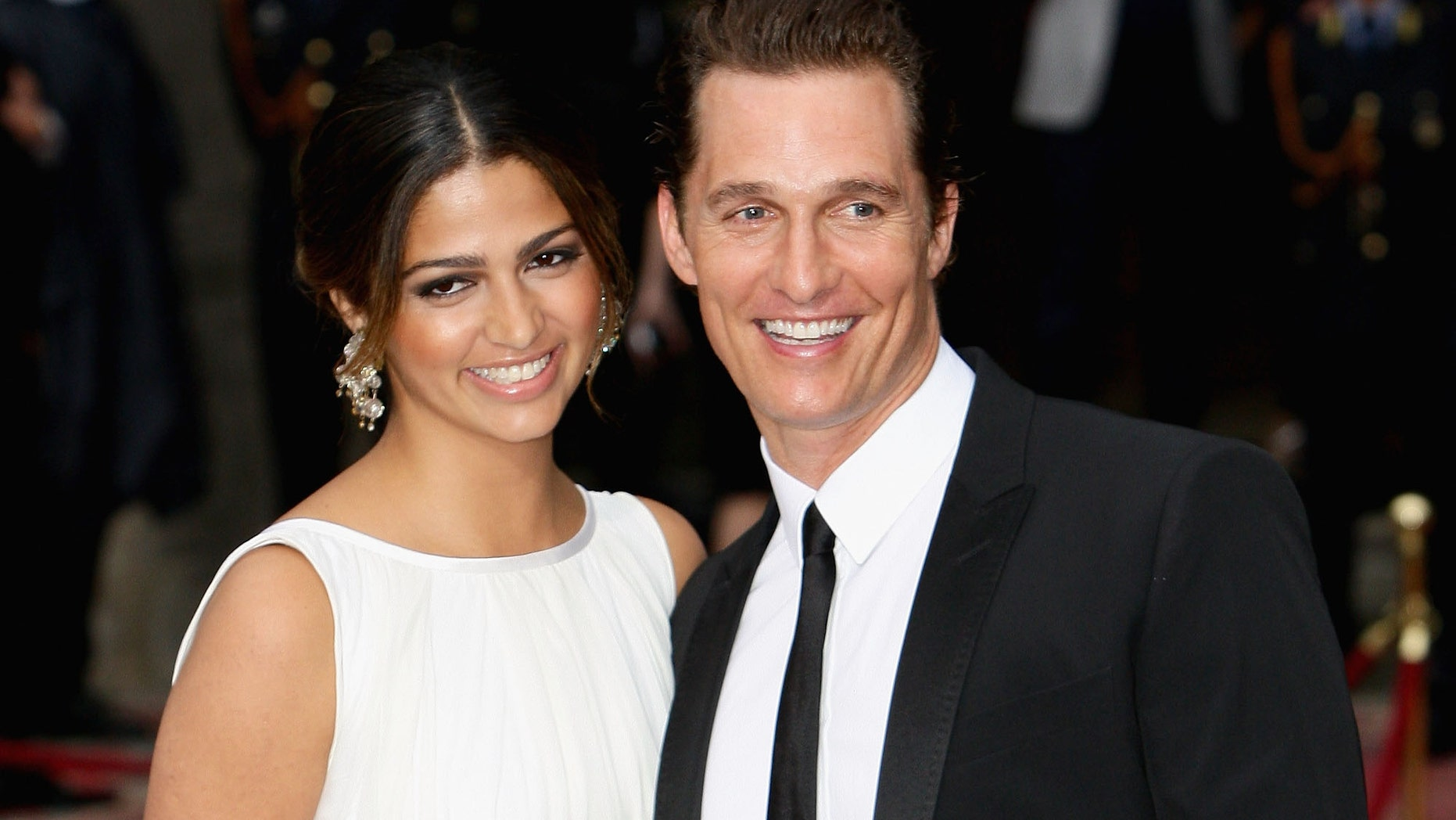 """MILAN, ITALY - JUNE 19:  Camila Alves and Matthew McConaughey attend the Dolce & Gabbana """"20 Years of Menswear"""" during Milan Fashion Week Spring/Summer 2011 on June 19, 2010 in Milan, Italy.  (Photo by Vittorio Zunino Celotto/Getty Images)"""