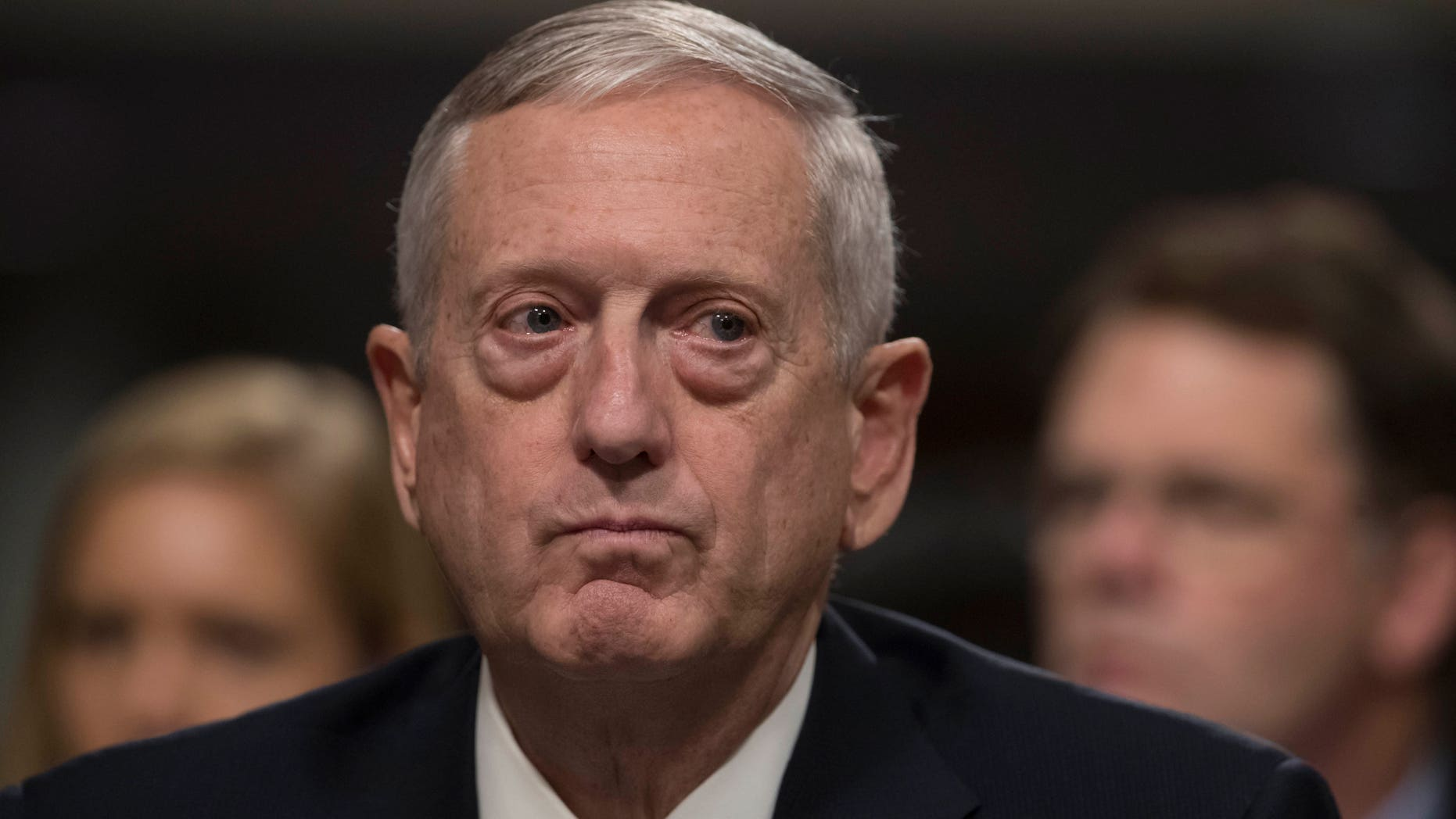 FILE - In this Jan. 12, 2017 file photo, Defense Secretary-designate James Mattis listens on Capitol Hill in Washington while testifying at his confirmation hearing before the Senate Armed Services Committee. Some of President-elect Donald Trump's most important Cabinet choices are at odds with him on matters that were dear to his heart as a campaigner and central to his promises to supporters. For the Pentagon, the CIA, the State Department and more, Trump has picked people who publicly disagree with him on some cornerstones of his agenda In confirmation hearings.  (AP Photo/J. Scott Applewhite, File)