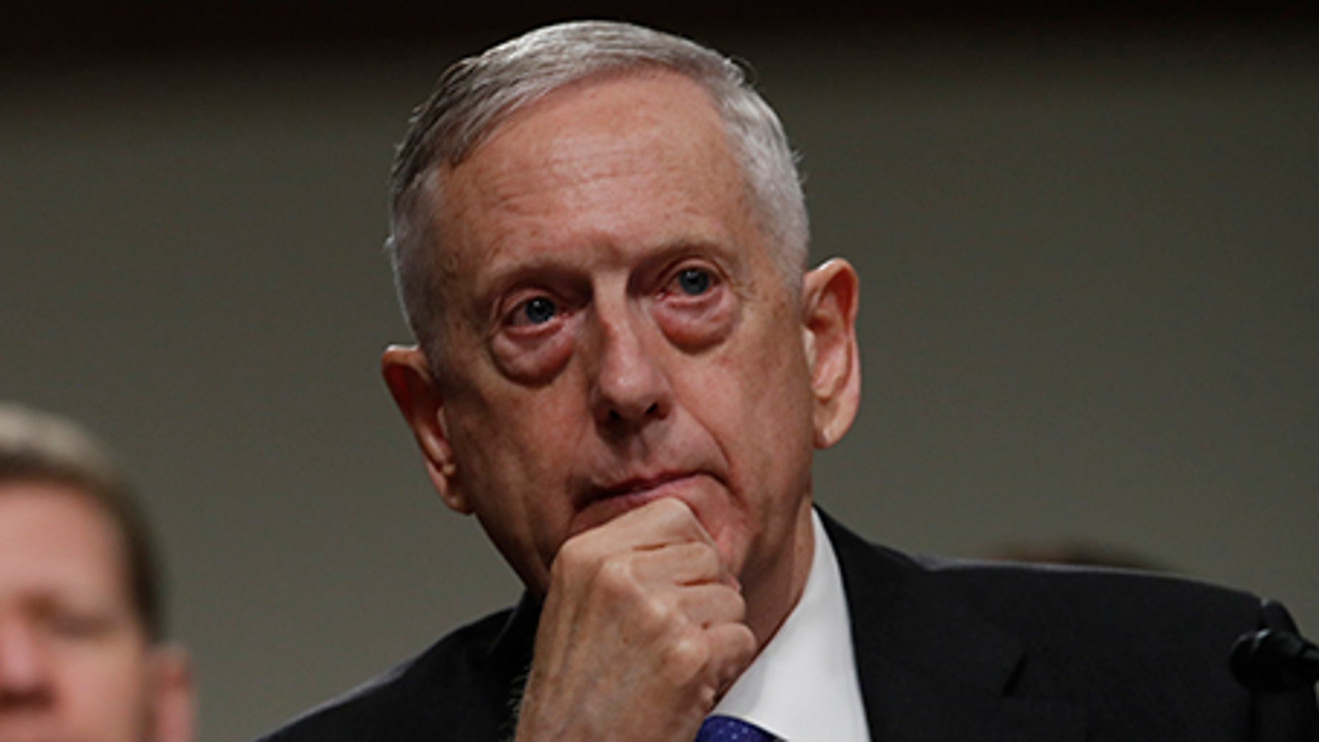 """Defense Secretary Jim Mattis listens on Capitol Hill in Washington. Mattis is issuing his own sharp threat to North Korea, saying the regime should cease any consideration of actions that would """"lead to the end of its regime and the destruction of its people."""""""