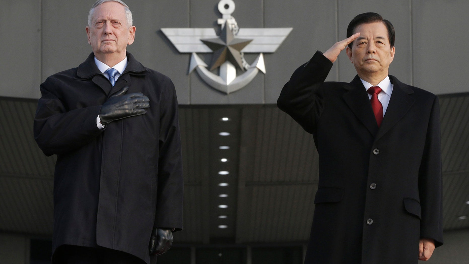 Feb. 3, 2017: U.S. Defense Secretary Jim Mattis, left, and South Korean Defense Minister Han Min Koo salute during a welcome ceremony for Mattis at the Defense Ministry in Seoul.