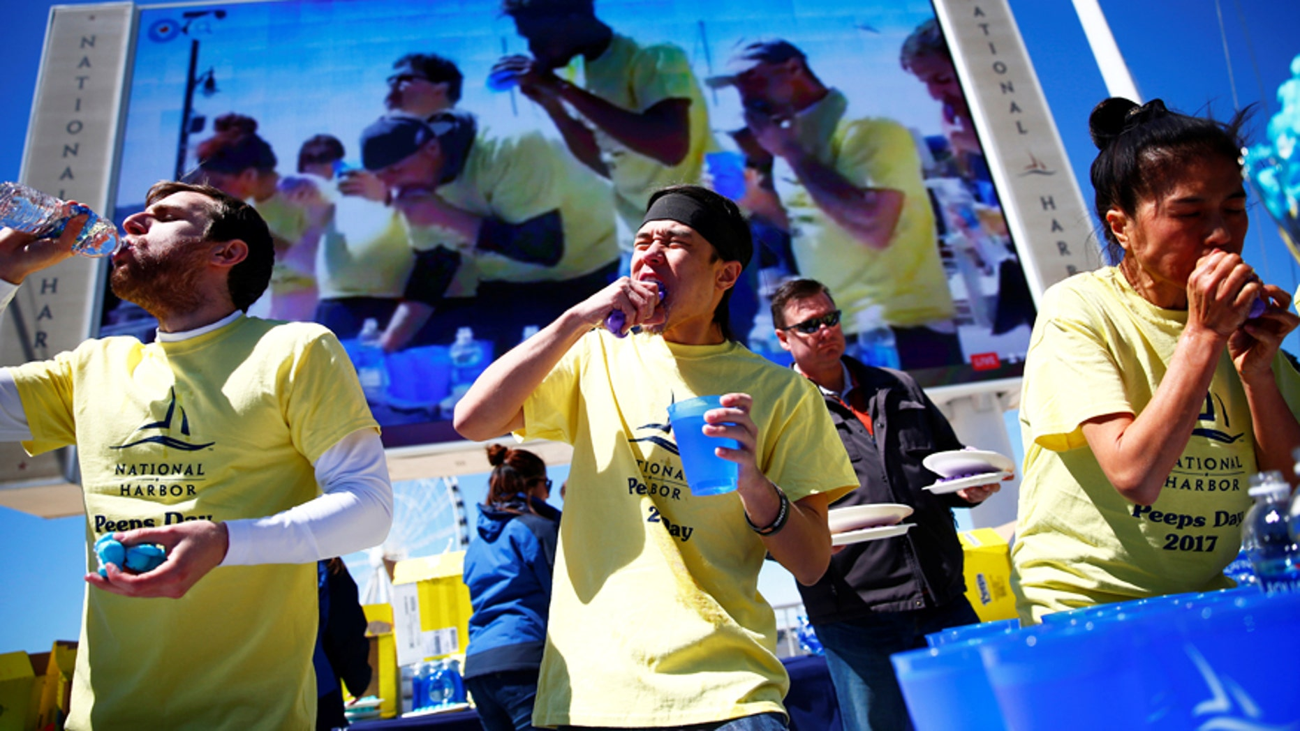 Matt Stonie is flanked by other competitors at the National Harbor World Peeps Eating Championship in National Harbor, Md.