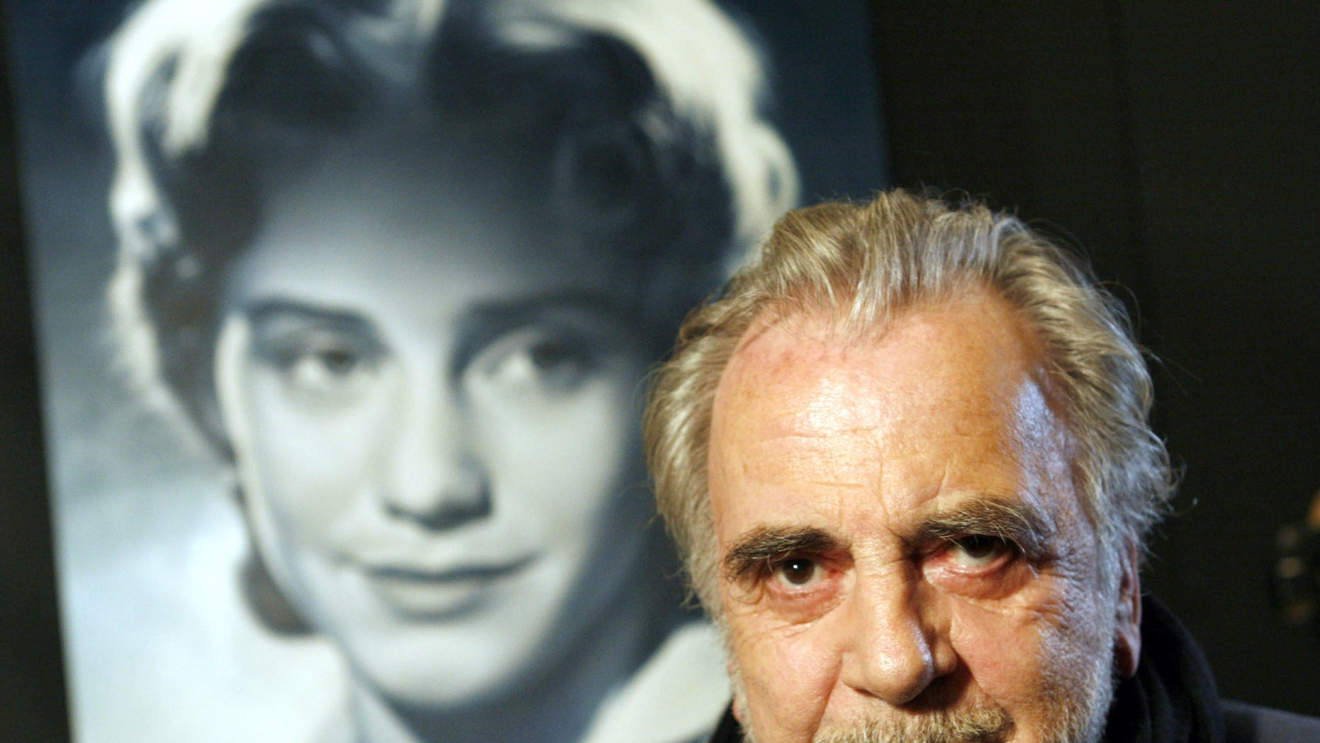 Jan. 30, 2007 file picture actor  Maximilian Schell poses in front of a poster of his sister Maria Schell in Frankfurt, Germany.