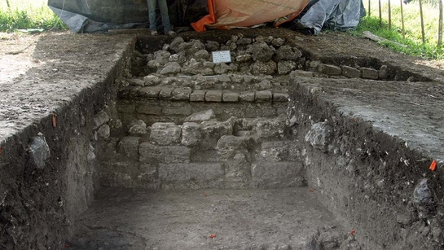 In the course of excavating remains of the Mayan city, archaeologists uncovered a corridor containing shiny white plaster that originally would have covered the city.