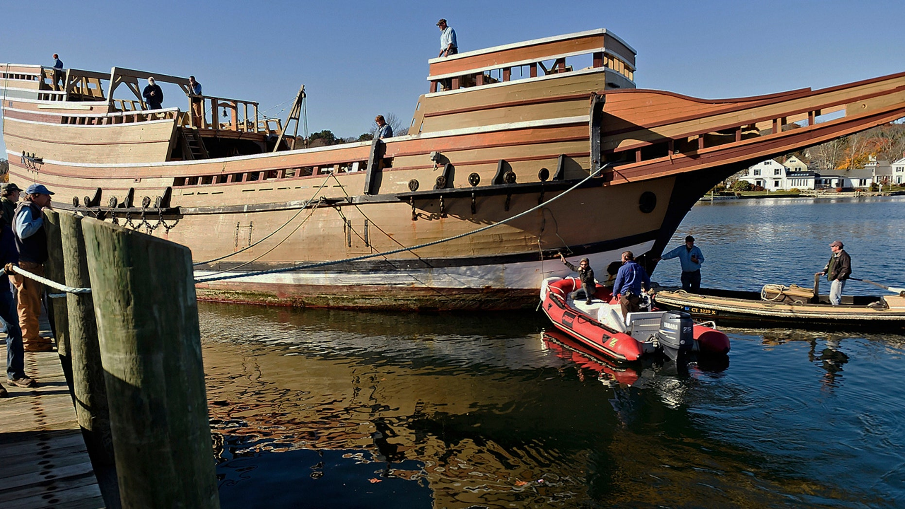 In this Nov. 18, 2016 photo, workers at Mystic Seaport move the Mayflower II from the dock into the ship-lift to be hauled out of the Mystic River at the Henry B. duPont Preservation Shipyard in Stonington, Conn.