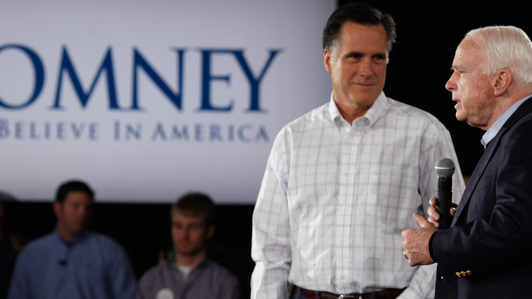 SALEM, NH - JANUARY 05:  Republican presidential candidate, former Massachusetts Governor Mitt Romney (L) and Sen. John McCain (R-AZ) hold a campaign town hall meeting at the Boys and Girls Club January 5, 2012 in Salem, New Hampshire. McCain, the GOP presidential nominee who ran against President Barack Obama in 2008, endorsed Romney on Wednesday. Romney eeked out an eight-vote victory in the Iowa Caucuses against former U.S. Senator Rick Santorum, who is also stumping in New Hampshire.  (Photo by Chip Somodevilla/Getty Images)